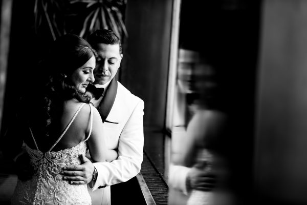 Black and white picture of a couple embracing on their wedding day. Photo taken by April & Bryan Photography in Lancaster, PA.