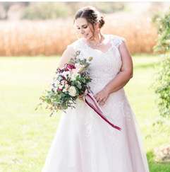 Woman in a white wedding dress holding a bouquet