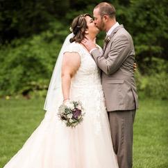 Woman kissing a man in a white wedding dress