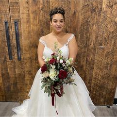 Woman wearing a white, sleeveless wedding dress