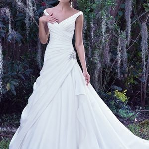 Long, white wedding dress with train and layers at Blush Bridal in Lancaster, PA