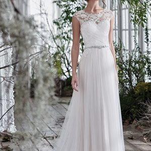 White wedding dress with beading details around the neck and waistline. Available at Blush Bridal in Lancaster, PA