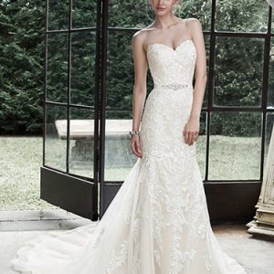 Ivory wedding dress with sweetheart neckline and lace details. Available at Blush Bridal in Lancaster, PA