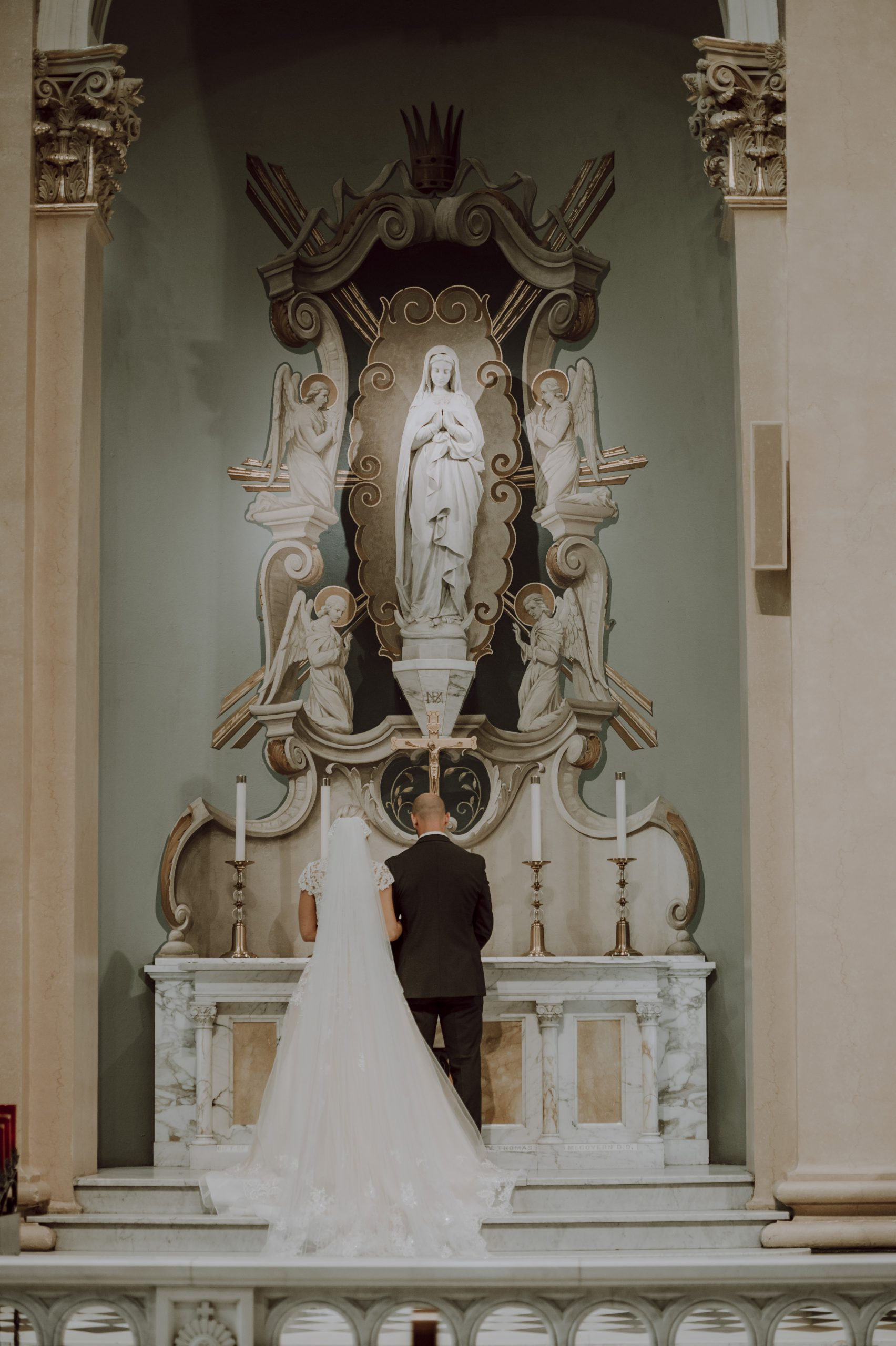 A prayer for the marriage and its prosperity. Captured by Lovefusion Photography at Stock's Manor in Mechanicsburg, PA. Featured on Dream Weddings.