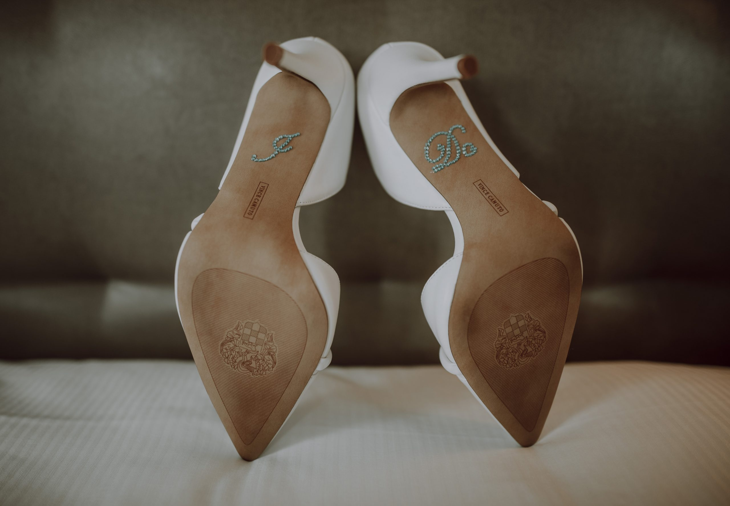 A bejeweled 'I Do' on the bottom of all white heels for the bride. Captured by Lovefusion Photography at Stock's Manor in Mechanicsburg, PA. Featured on Dream Weddings.
