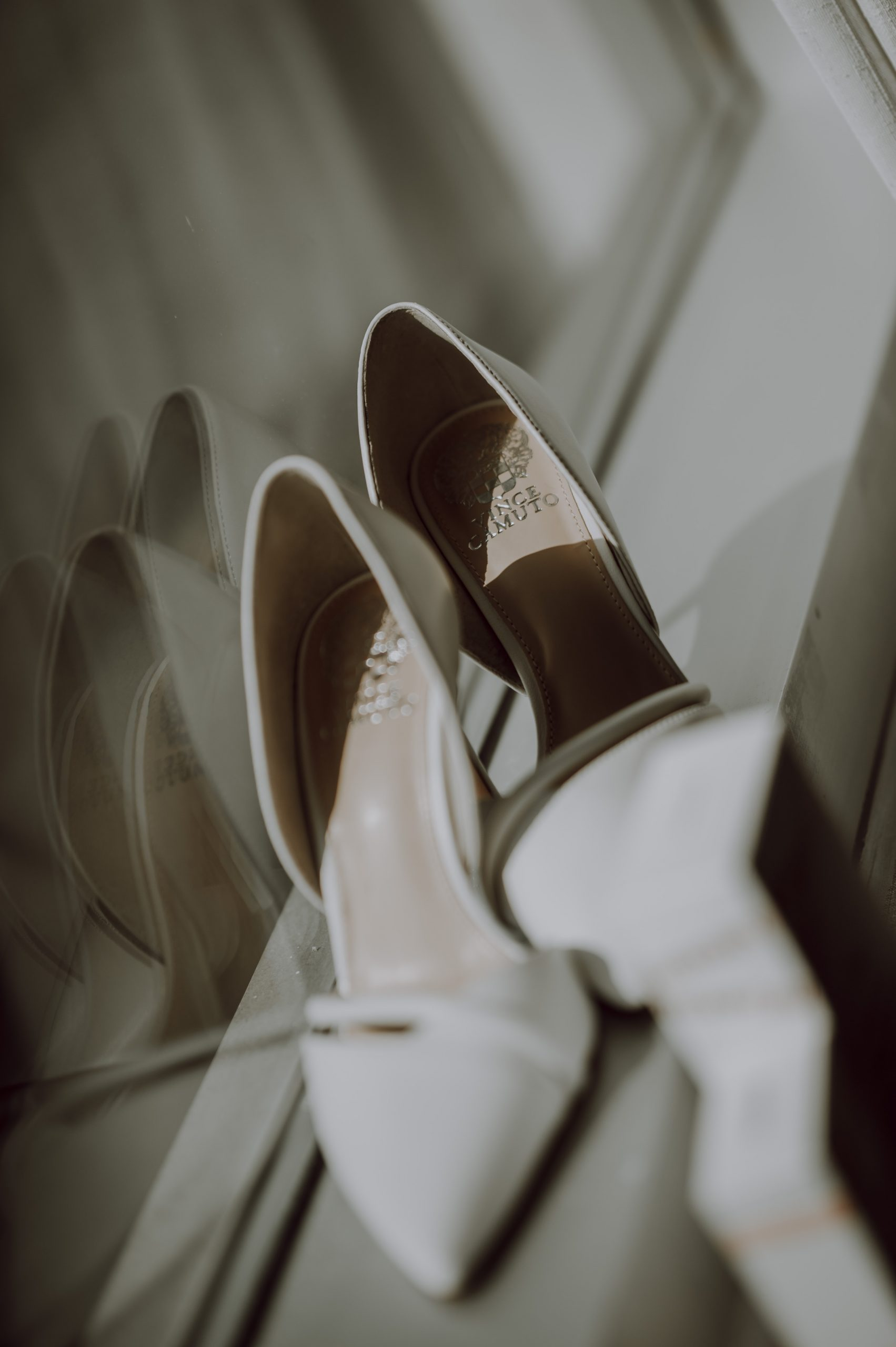 The white shoes that will be remembered for the rest of her life. Captured by Lovefusion Photography at Stock's Manor in Mechanicsburg, PA. Featured on Dream Weddings.