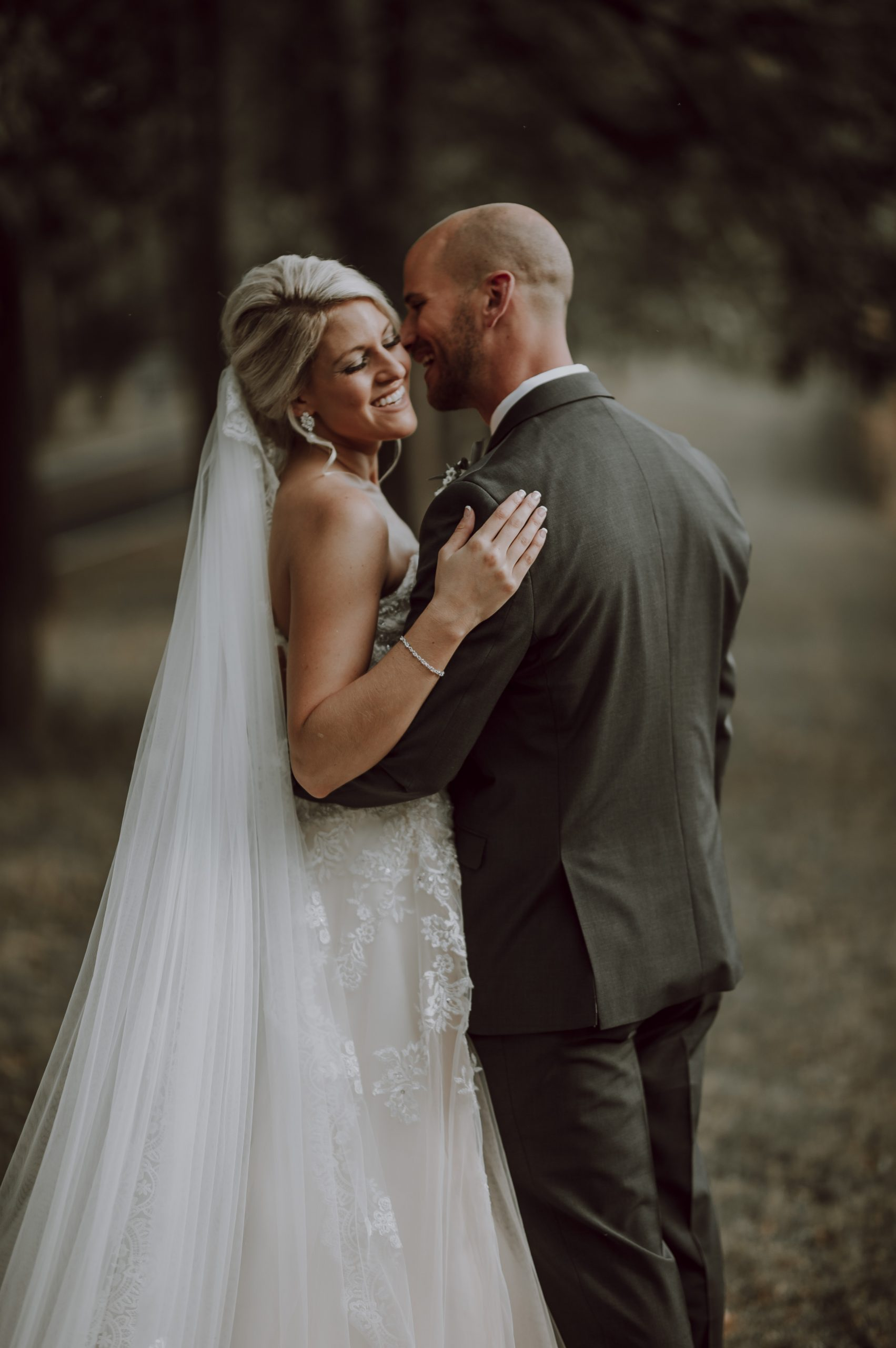 Laughing in love. Elegant bride with dapper groom. Captured by Lovefusion Photography at Stock's Manor in Mechanicsburg, PA. Featured on Dream Weddings.