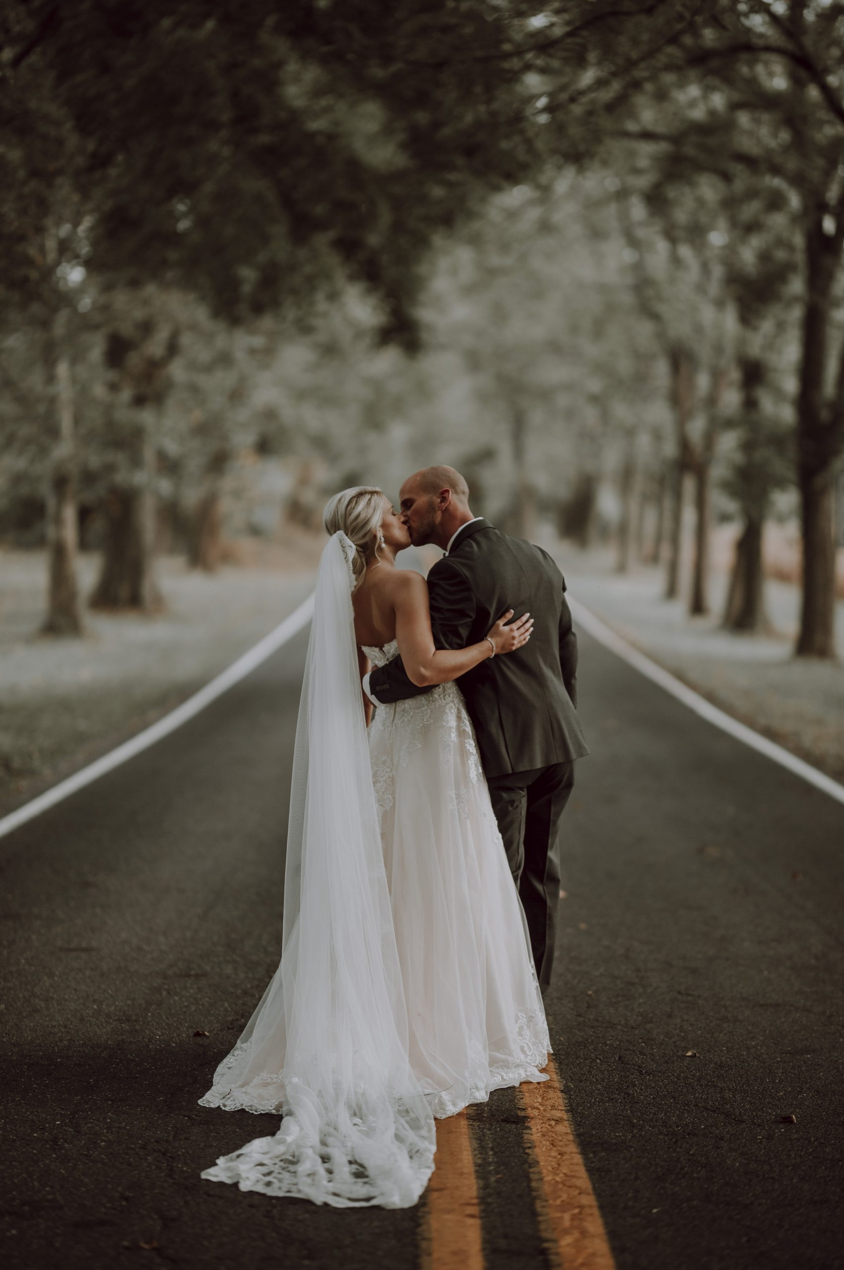Loving newly wedded couple on their road to the rest of their lives. Captured by Lovefusion Photography at Stock's Manor in Mechanicsburg, PA. Featured on Dream Weddings.