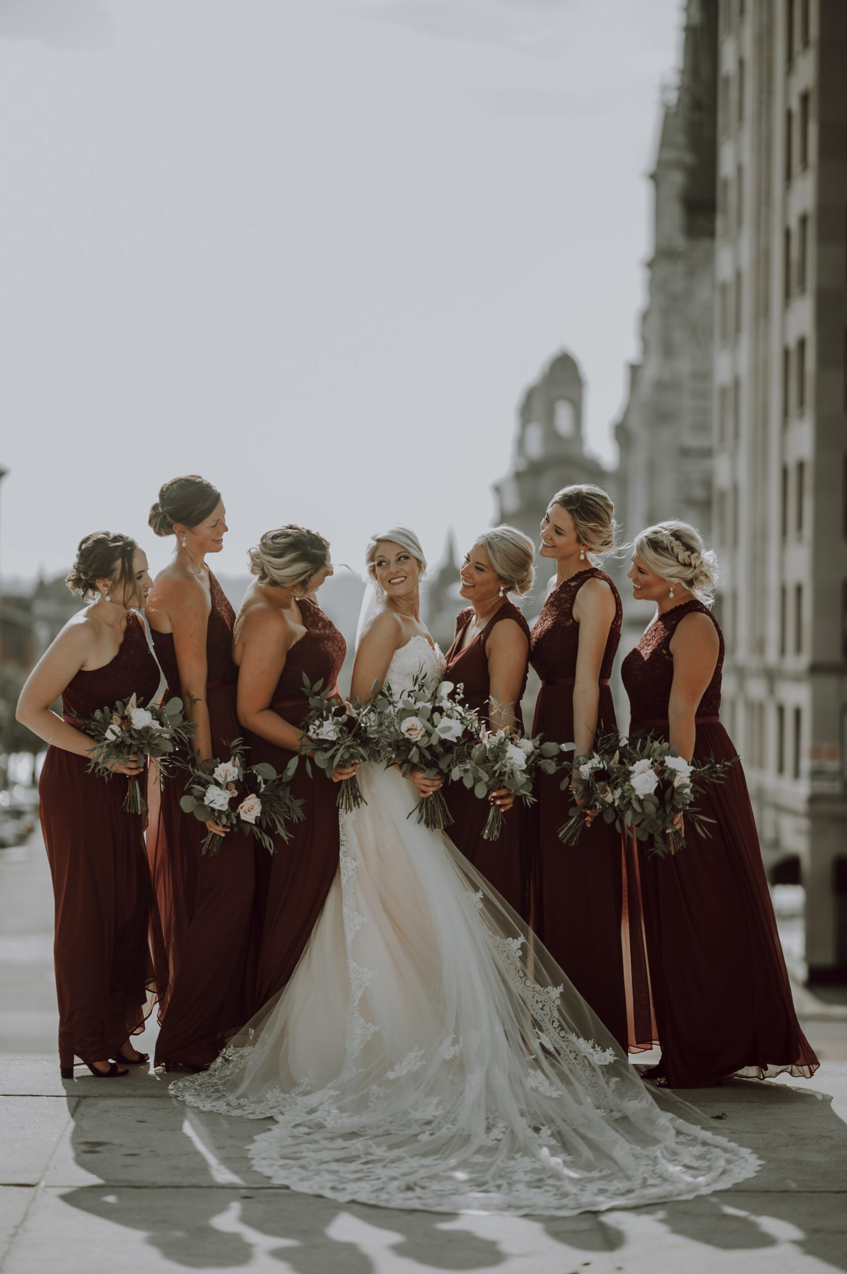 Gazing upon the blushing bride. Captured by Lovefusion Photography at Stock's Manor in Mechanicsburg, PA. Featured on Dream Weddings.