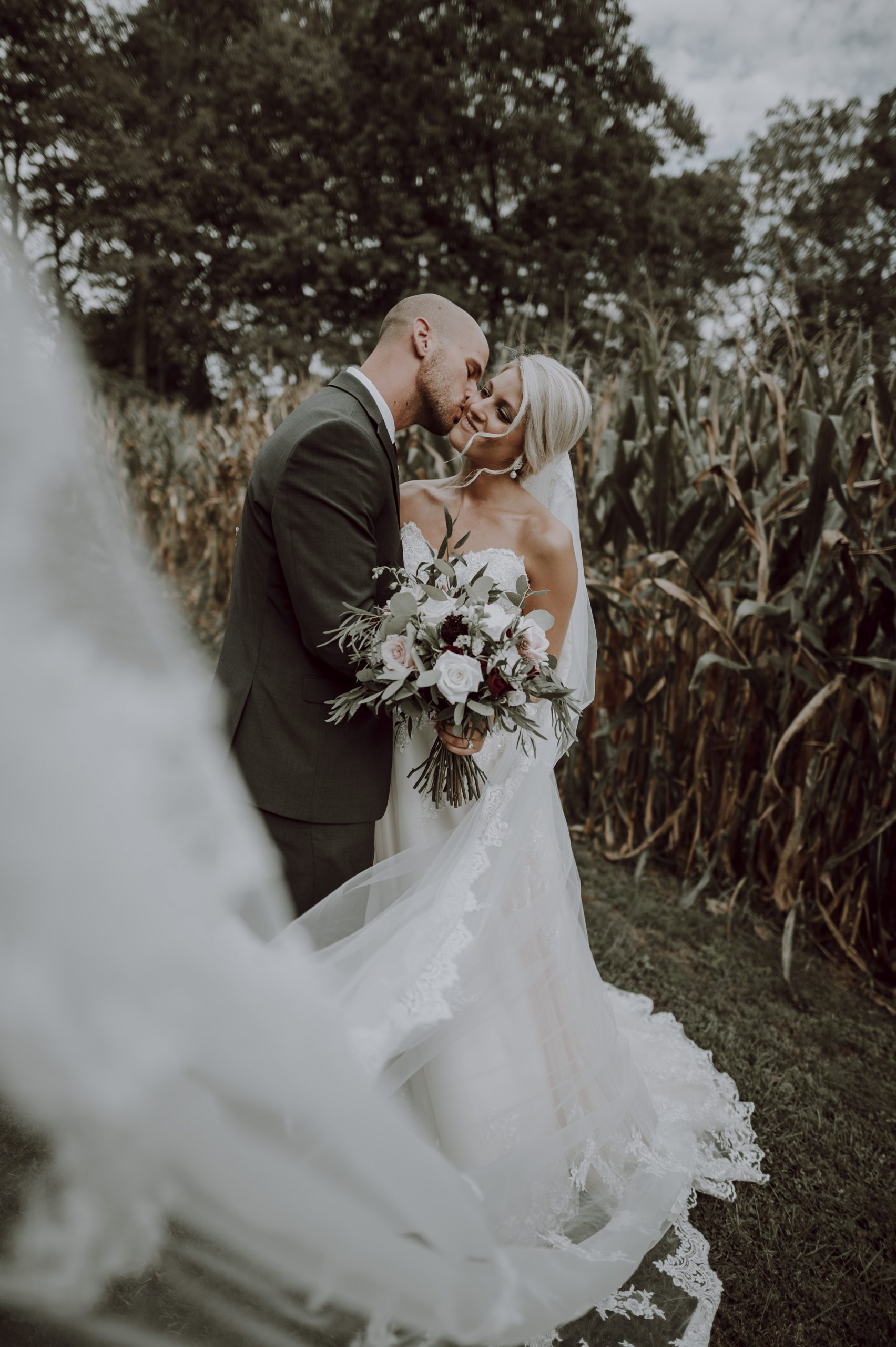 A veil for the ages. Flowing in the wind, sealed with a kiss. Captured by Lovefusion Photography at Stock's Manor in Mechanicsburg, PA. Featured on Dream Weddings.