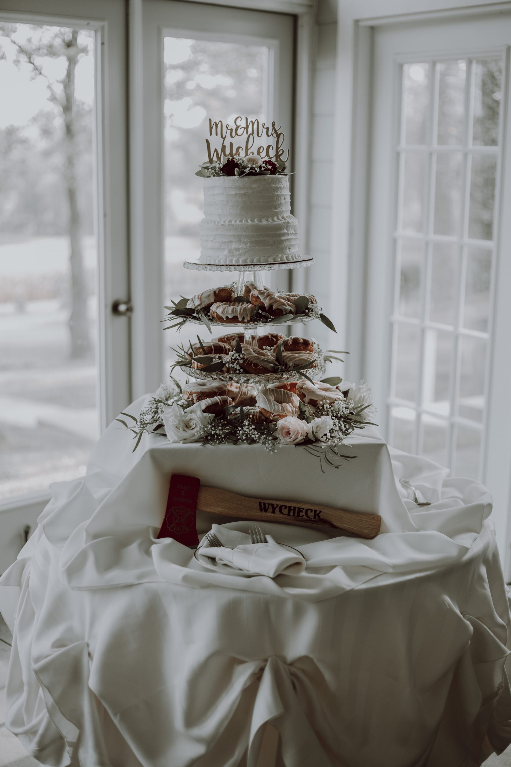 Who knew a cake covered in greens could be so alluring. Captured by Lovefusion Photography at Stock's Manor in Mechanicsburg, PA. Featured on Dream Weddings.