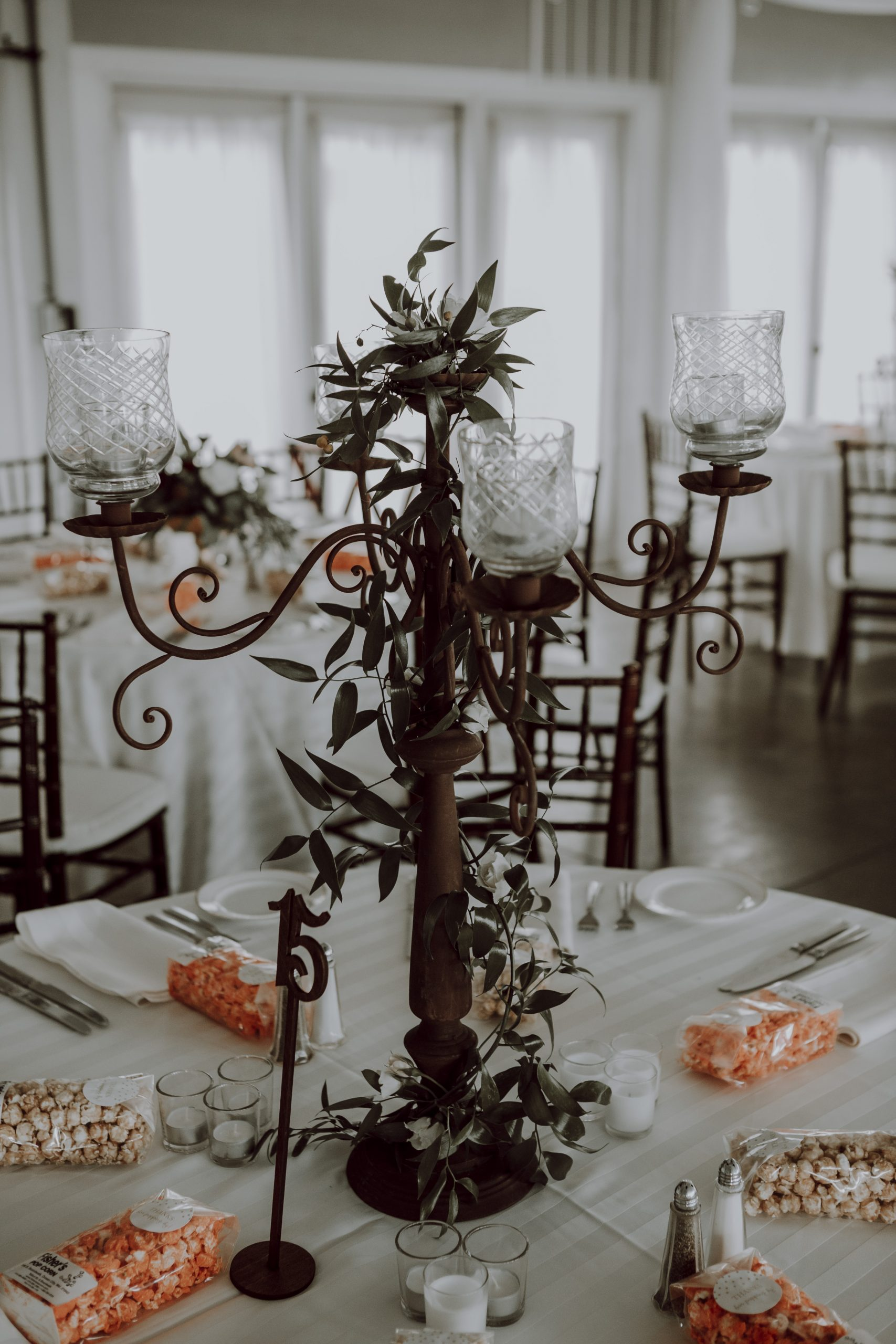 Elaborate candle holders mimick that of the greenery on a beautifully romantic tablescpae. Captured by Lovefusion Photography at Stock's Manor in Mechanicsburg, PA. Featured on Dream Weddings.