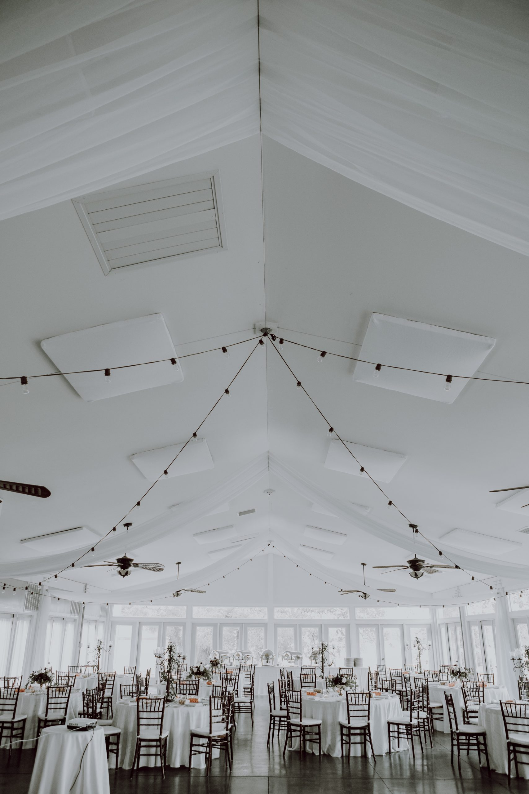 Pure white venue is a clean start to a new marriage. Captured by Lovefusion Photography at Stock's Manor in Mechanicsburg, PA. Featured on Dream Weddings.