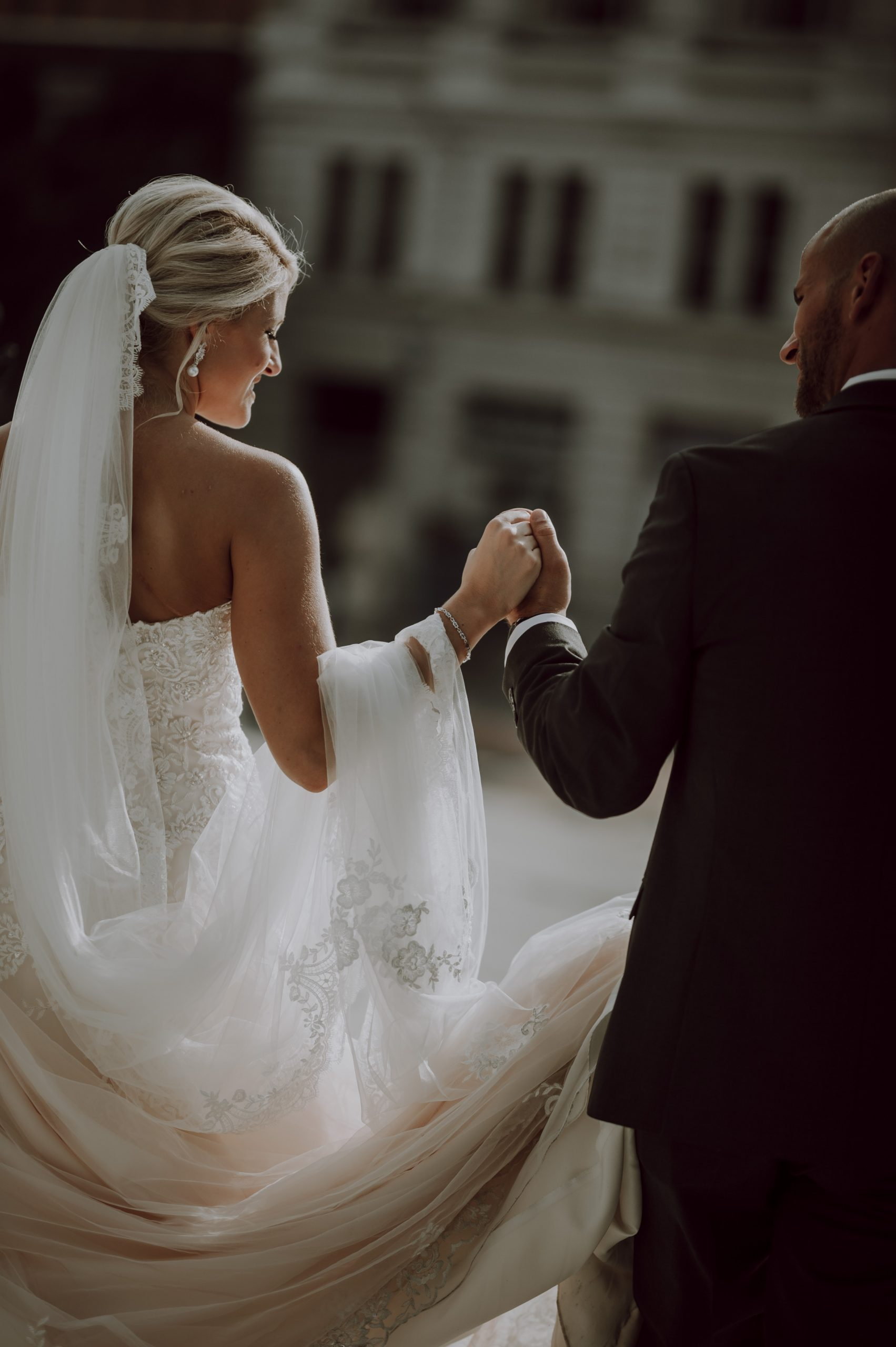 Bride and broom lead each other hand in hand. Captured by Lovefusion Photography at Stock's Manor in Mechanicsburg, PA. Featured on Dream Weddings.