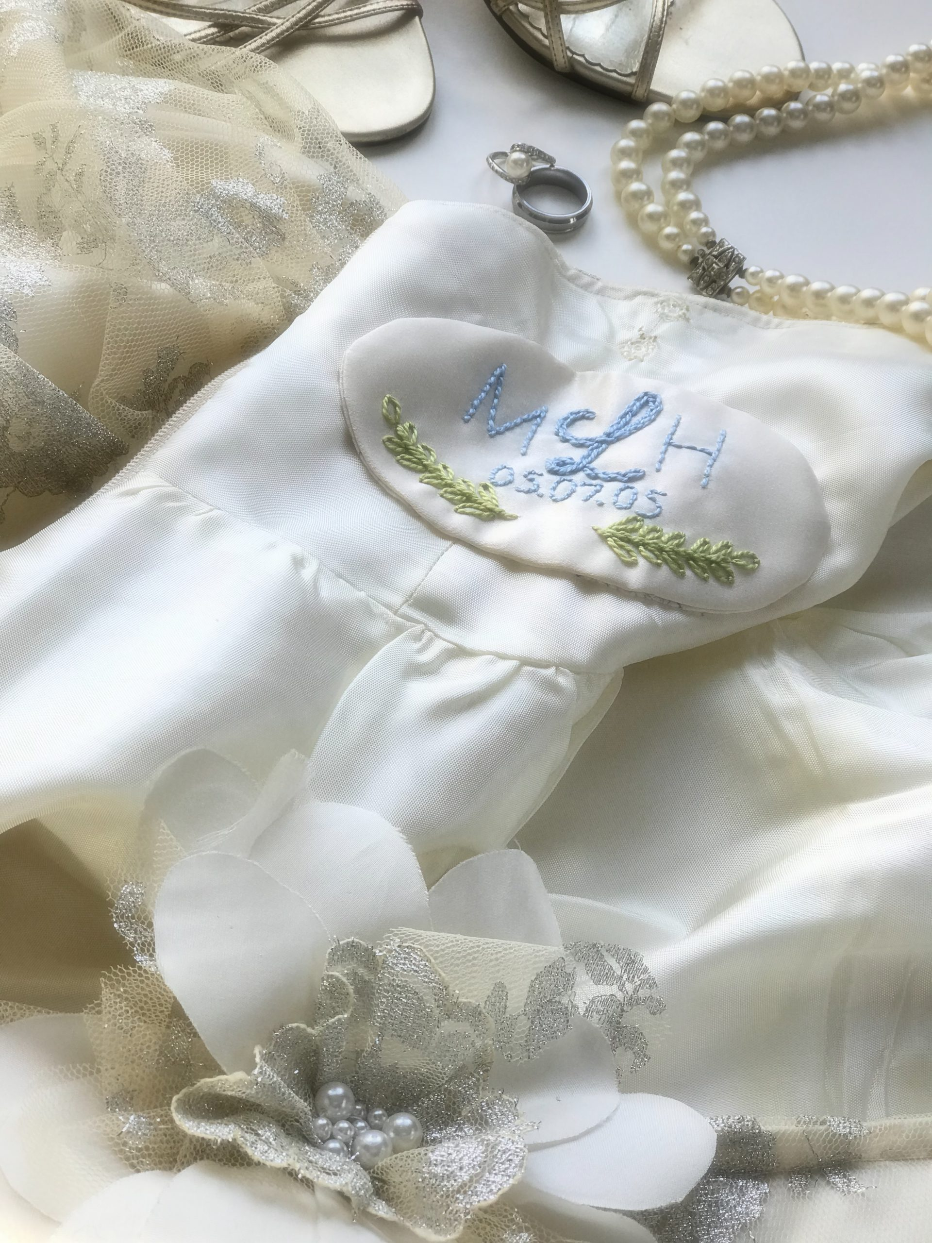 Embroidery done on the dress of a future bride done by Megan Hamilton Weddings. Featured on Dream Weddings.