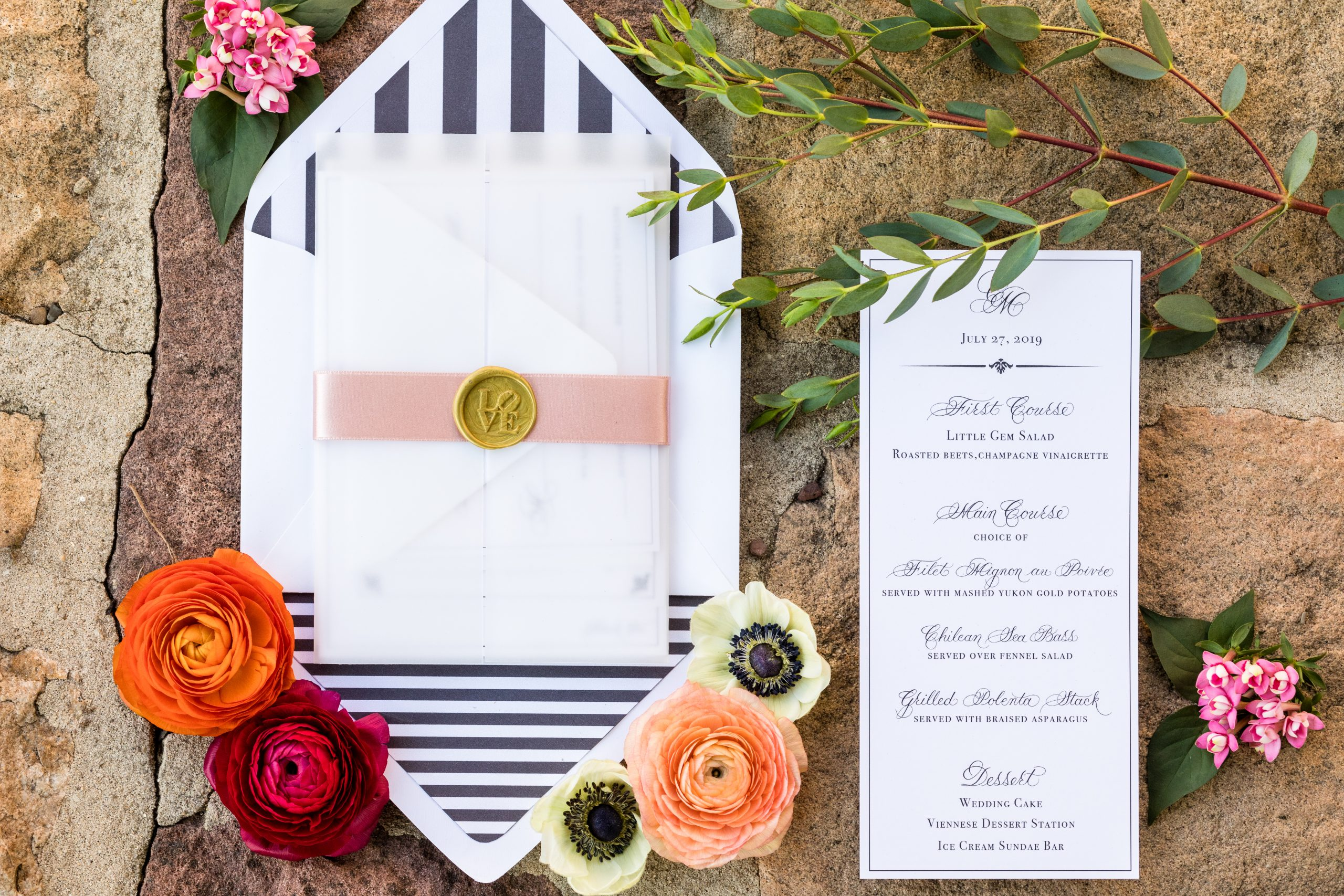 Invition envelopes as well as dinner choices garnished with orange, red, pink and white flowers at the Michener Museum styled urban contemporary shoot for Ashley Gerrity Photography this past Summer. Featured on Dream Weddings.