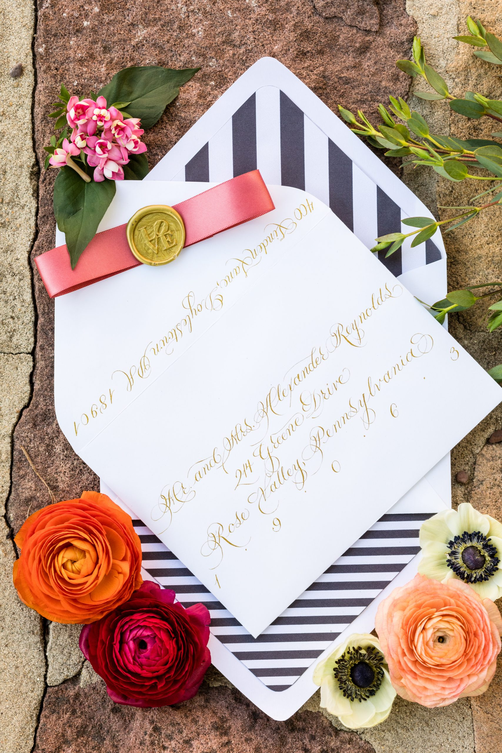 Gold calligraphy partnered with a black and white stripped envelope screams luxury at the Michener Museum styled urban contemporary shoot for Ashley Gerrity Photography this past Summer. Featured on Dream Weddings.