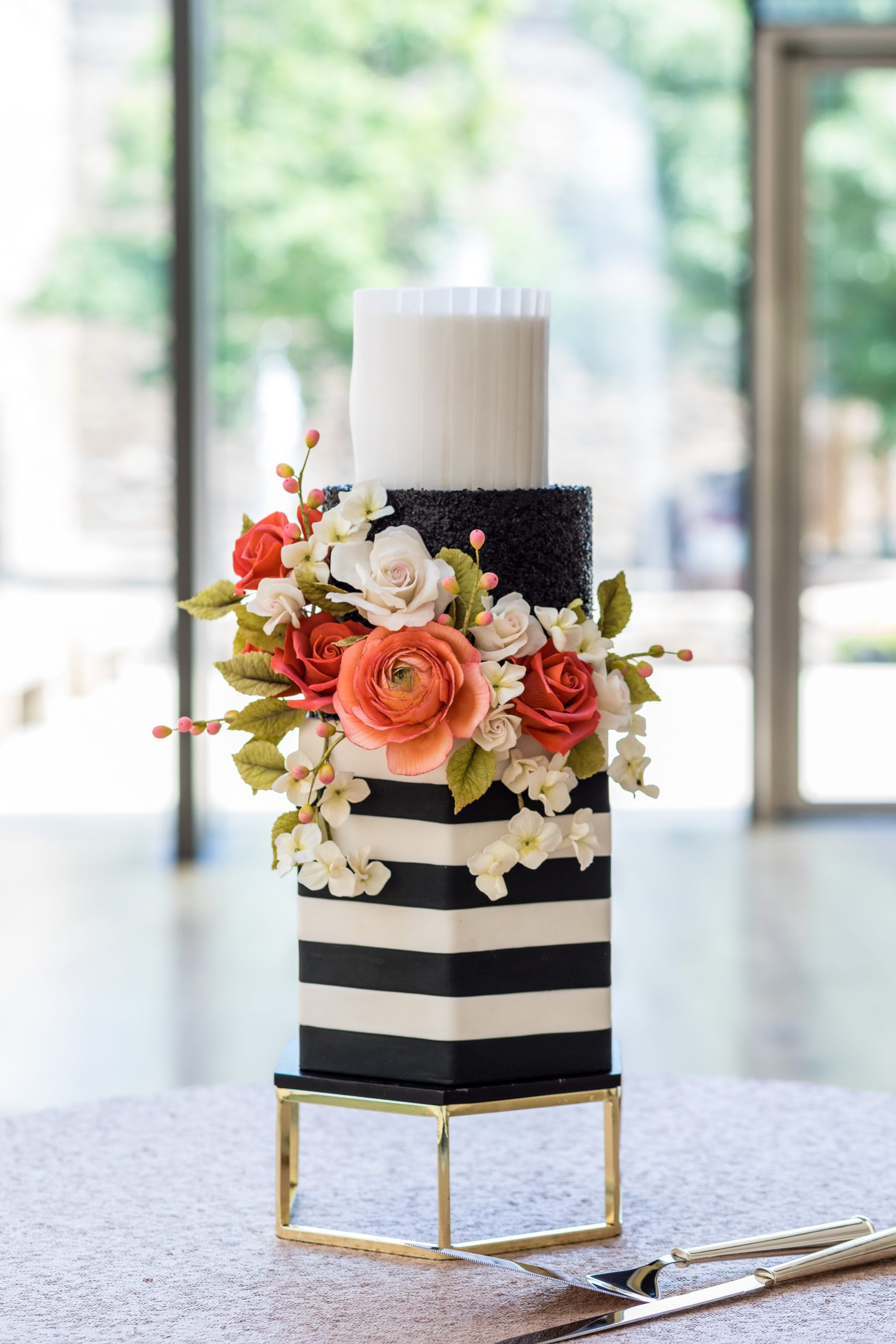 A decadent cake styled with lavish gold and real flowers at the Michener Museum styled urban contemporary shoot for Ashley Gerrity Photography this past Summer. Featured on Dream Weddings.