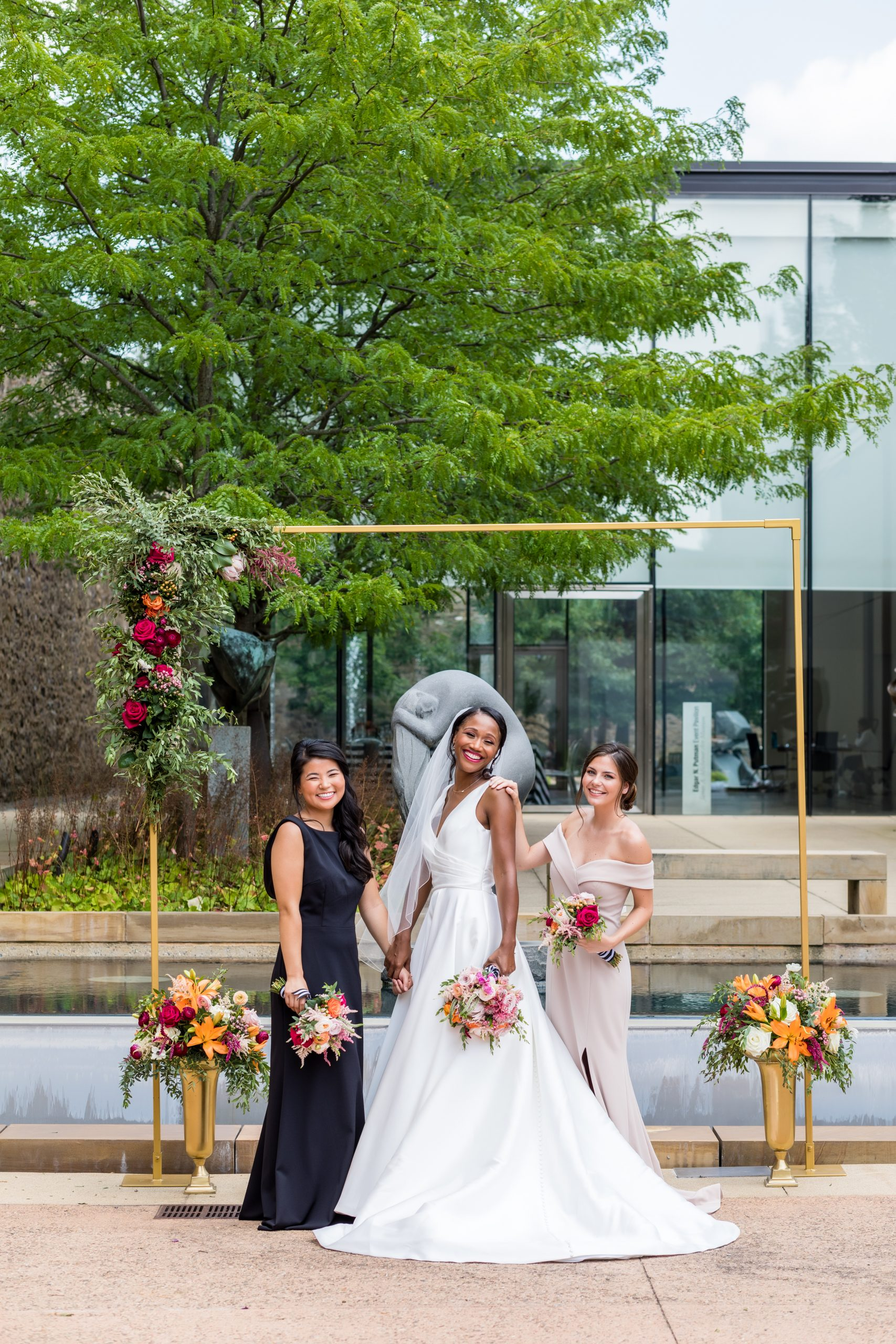 Sisterhood of the bridal party framed in gold with floral accents at the Michener Museum styled urban contemporary shoot for Ashley Gerrity Photography this past Summer. Featured on Dream Weddings.