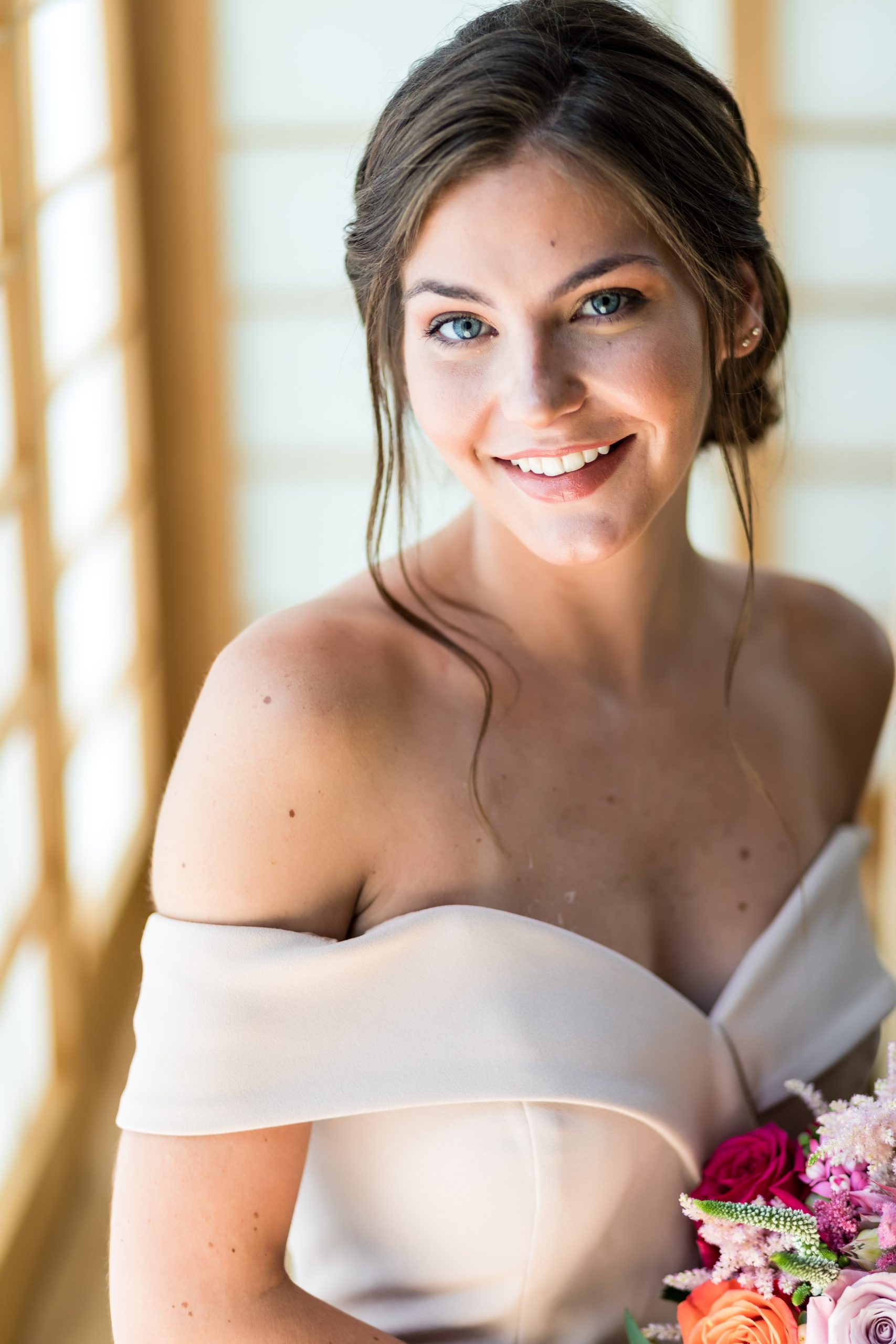 Detailed shot of a bridesmaid with an off the shoulder, sweetheart neckline classic dress at the Michener Museum styled urban contemporary shoot for Ashley Gerrity Photography this past Summer. Featured on Dream Weddings.