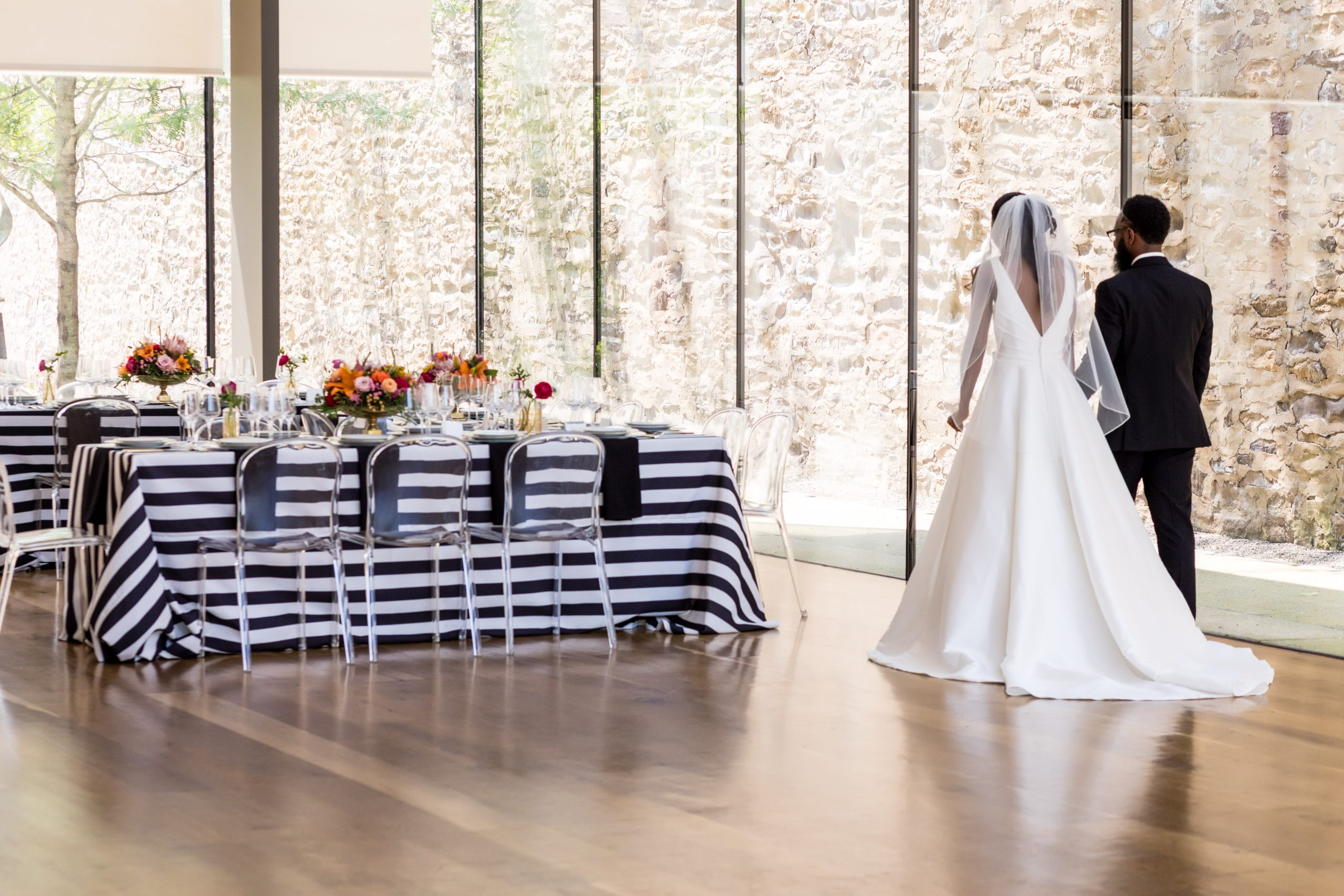 The bride and groom walking into this stunning styled reception at the Michener Museum styled urban contemporary shoot for Ashley Gerrity Photography this past Summer. Featured on Dream Weddings.