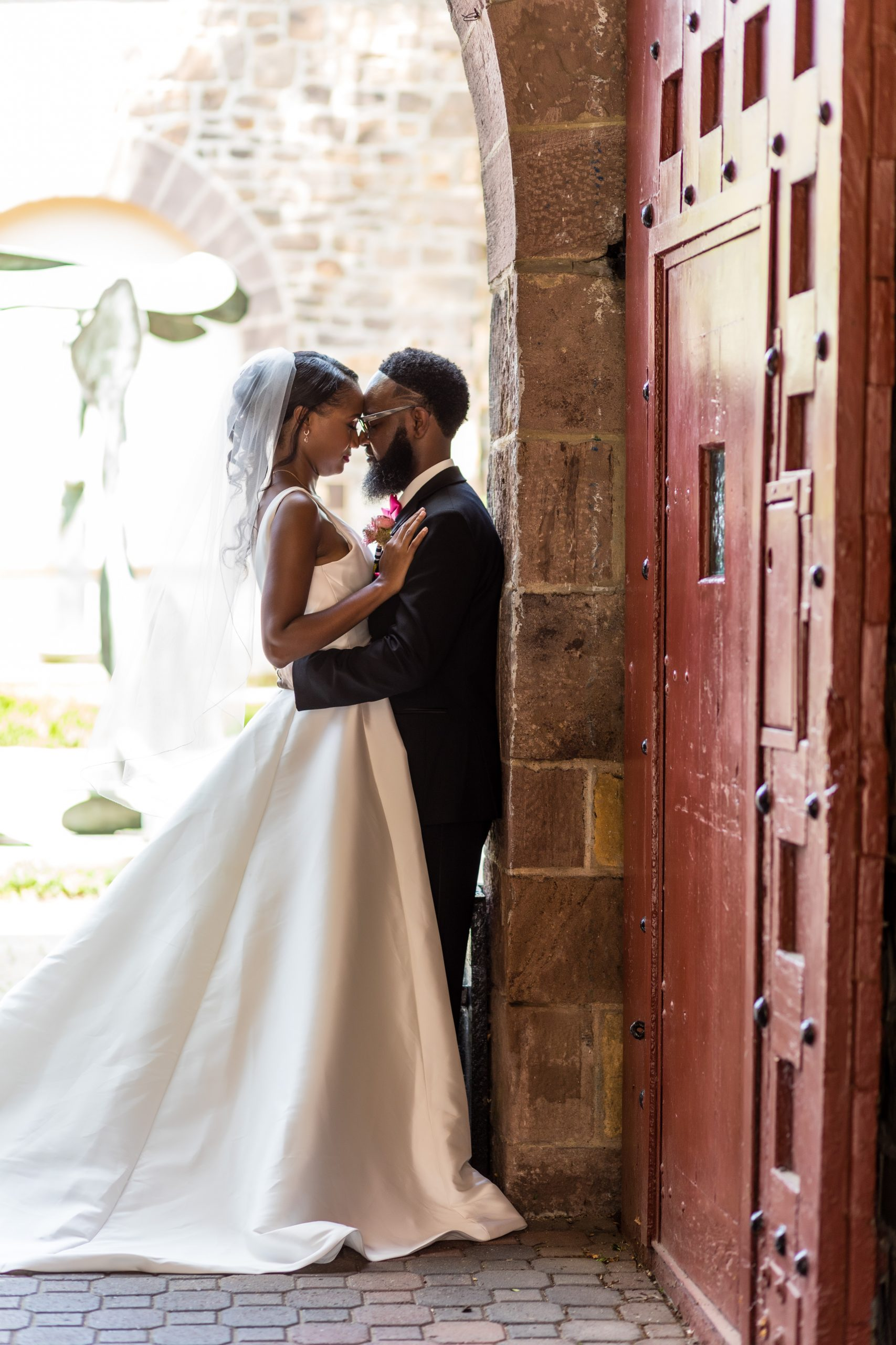 Couple in a romantic embrace at the Michener Museum hosted the styled urban contemporary shoot for Ashley Gerrity Photography this past Summer. Featured on Dream Weddings.