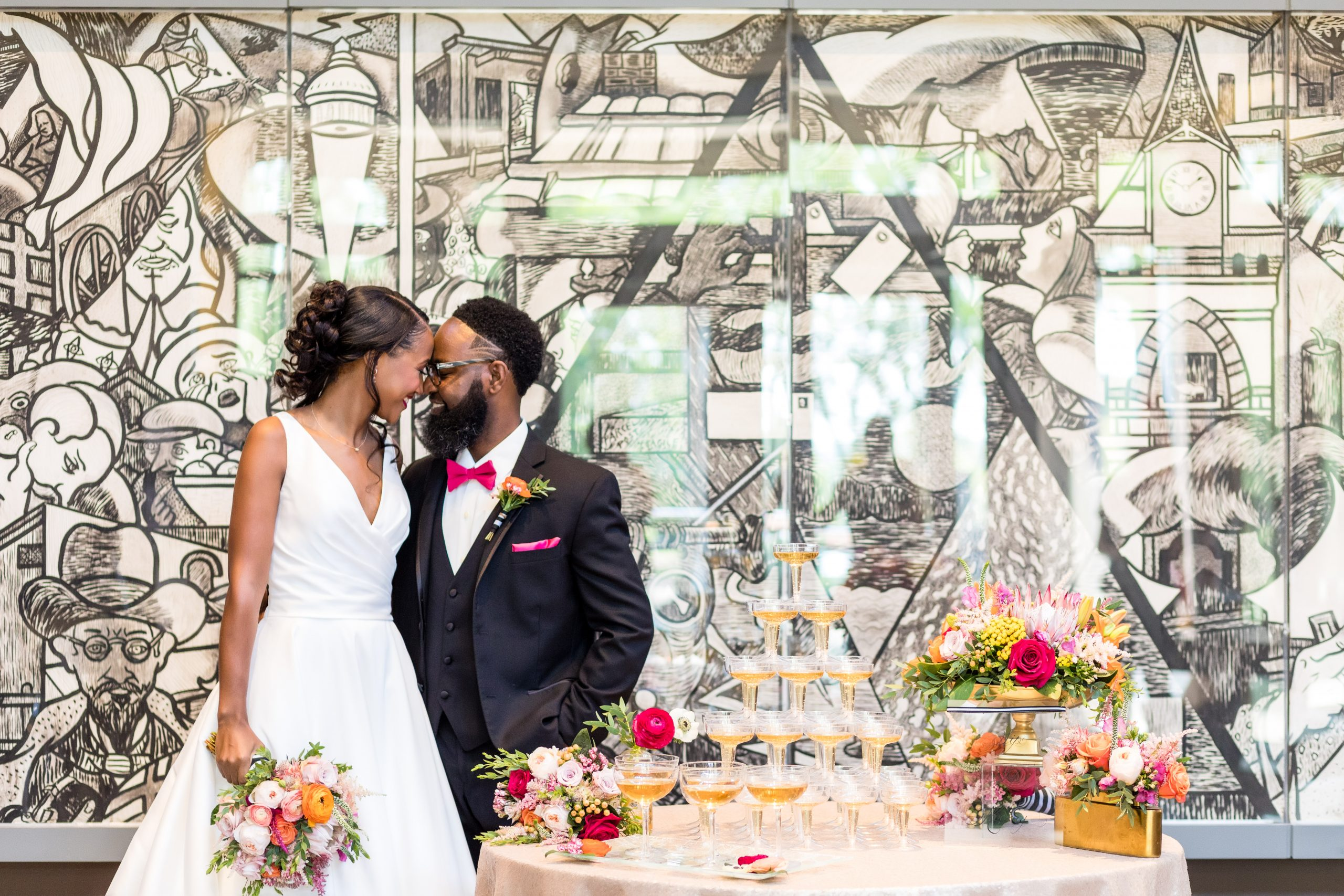 A playful head touch next to a luxurious table adorned with flowers and champagne at the Michener Museum styled urban contemporary shoot for Ashley Gerrity Photography this past Summer. Featured on Dream Weddings.
