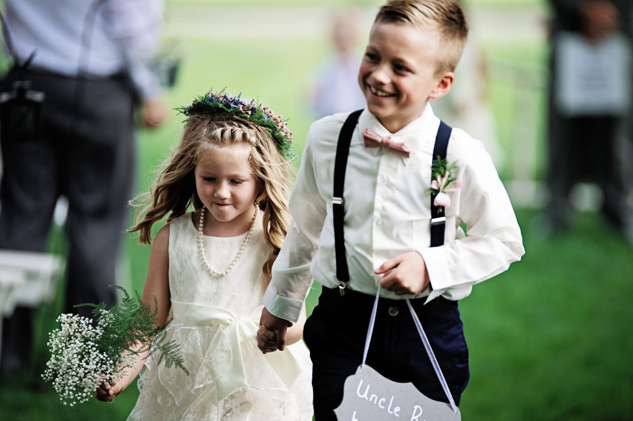 """This sibling duo proudly walk down the isle before their Uncle Ricky says, """"I do,"""" at Lakeview Farms in York, PA. Lovefusion Photography is accredited to capturing such an adorable photo. Featured in Dream Weddings."""