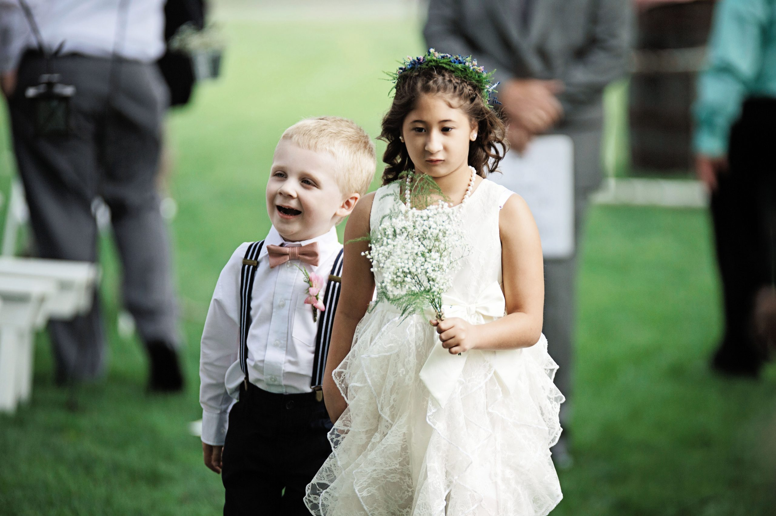 Flower girl and ring bearer make their way down the isle at Lakeview Farms of York, PA. Lovefusion effortlessly capturing this moment. Featured in Dream Weddings.