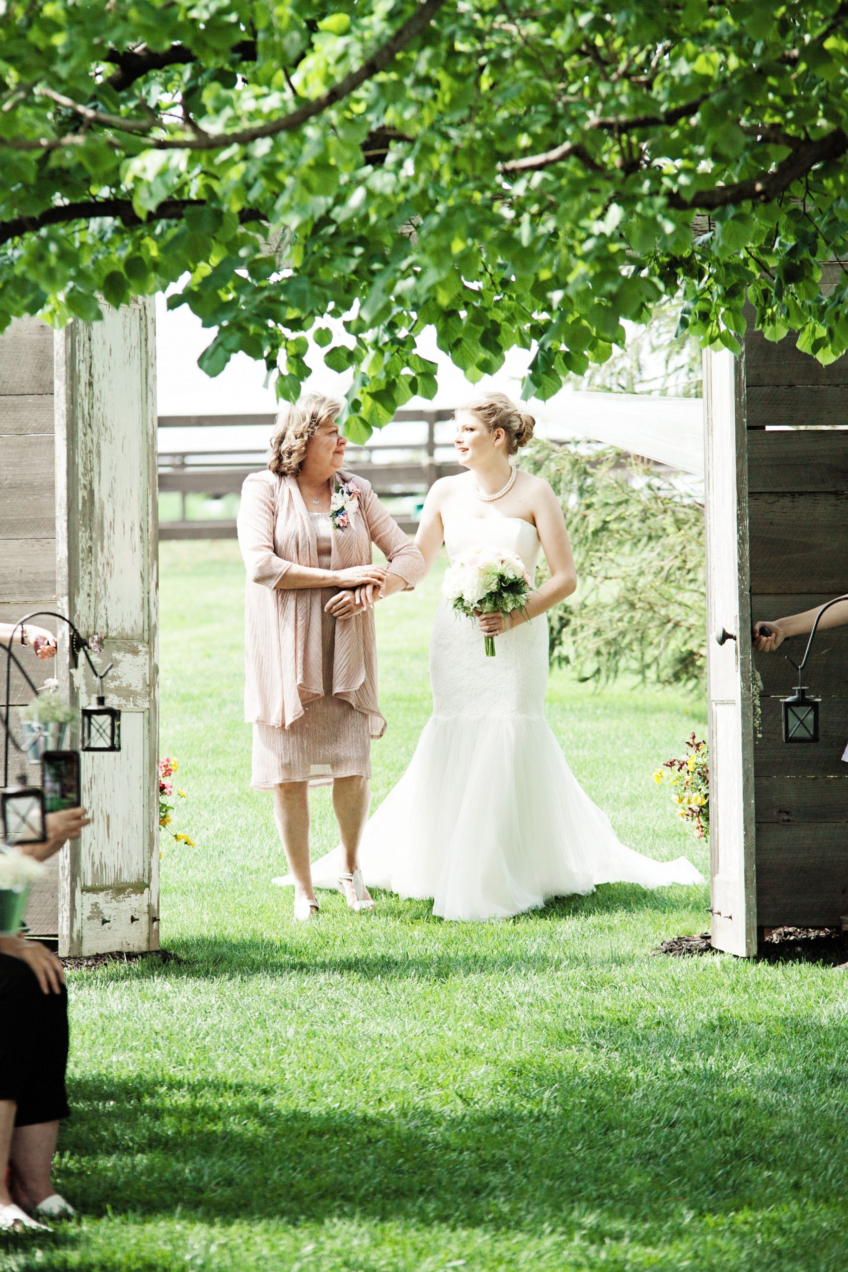 Mother of the bride emotionally holds the arm of her soon to be married daughter at Lakeview Farms of York, PA. Lovefusion Photography did a wonderful job of showcasing this moment. Featured in Dream Weddings.