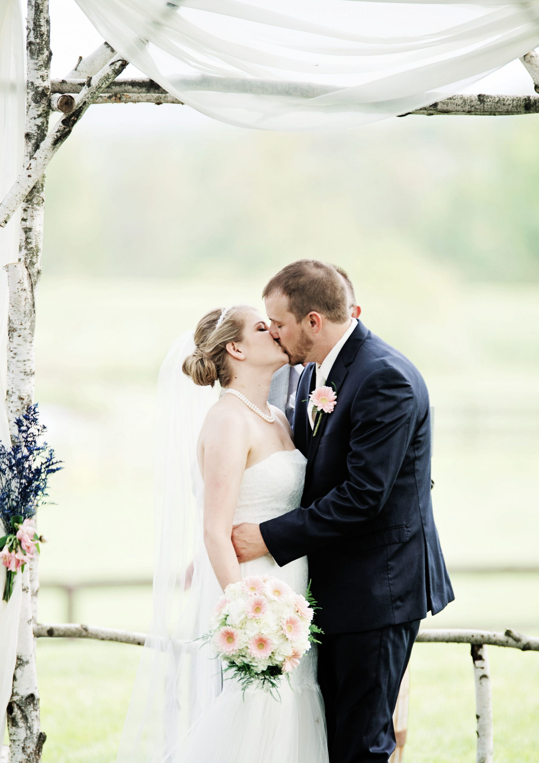 They do! The couple kisses for their first time as a married couple at Lakeview Farms in York, PA. Photographed by Lovefusion Photography. Featured in Dream Weddings.