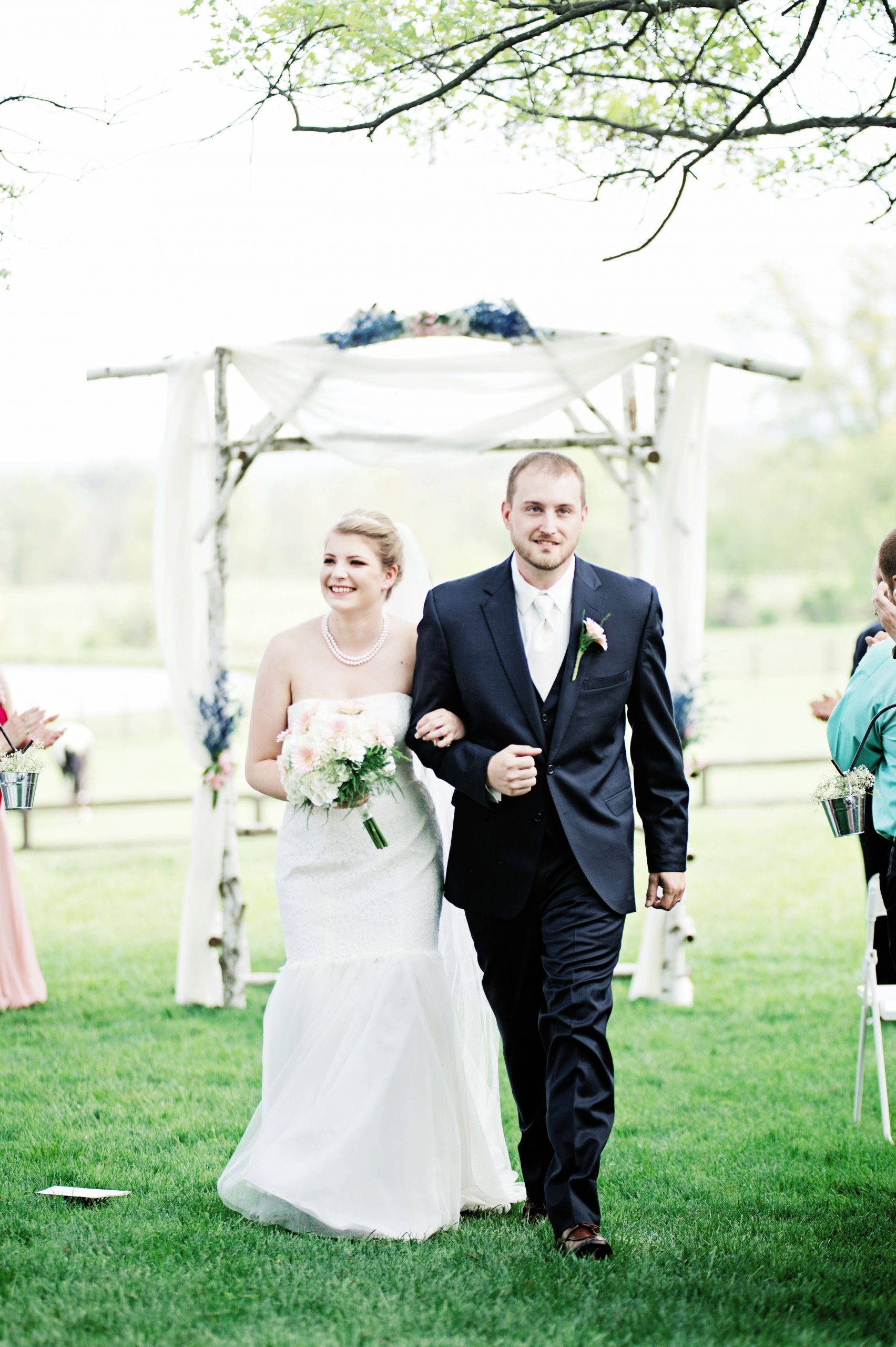 Newly wedded, the loving couple walks back down the isle of Lakeview farms in York, PA. Lovefusion Photography credited for this wonderful shot Featured in Dream Weddings.