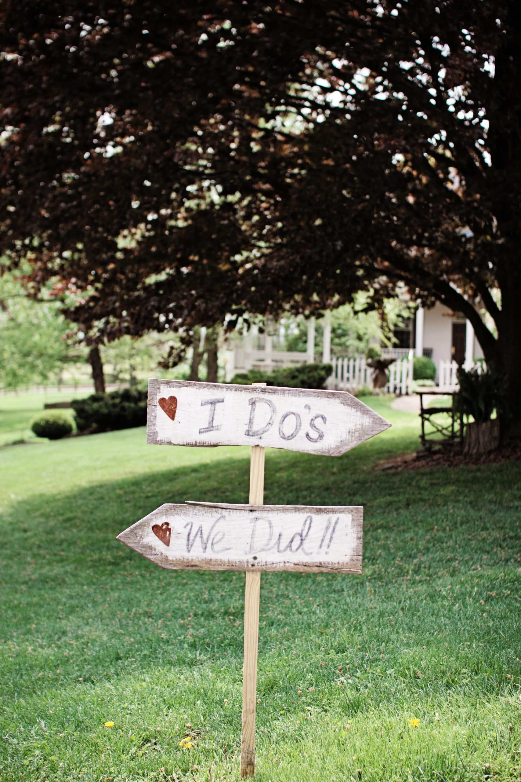 Arrows directing the guests to the wedding at Lakeview Farms in York, PA. Photographed by Lovefusion Photography. Featured in Dream Weddings.