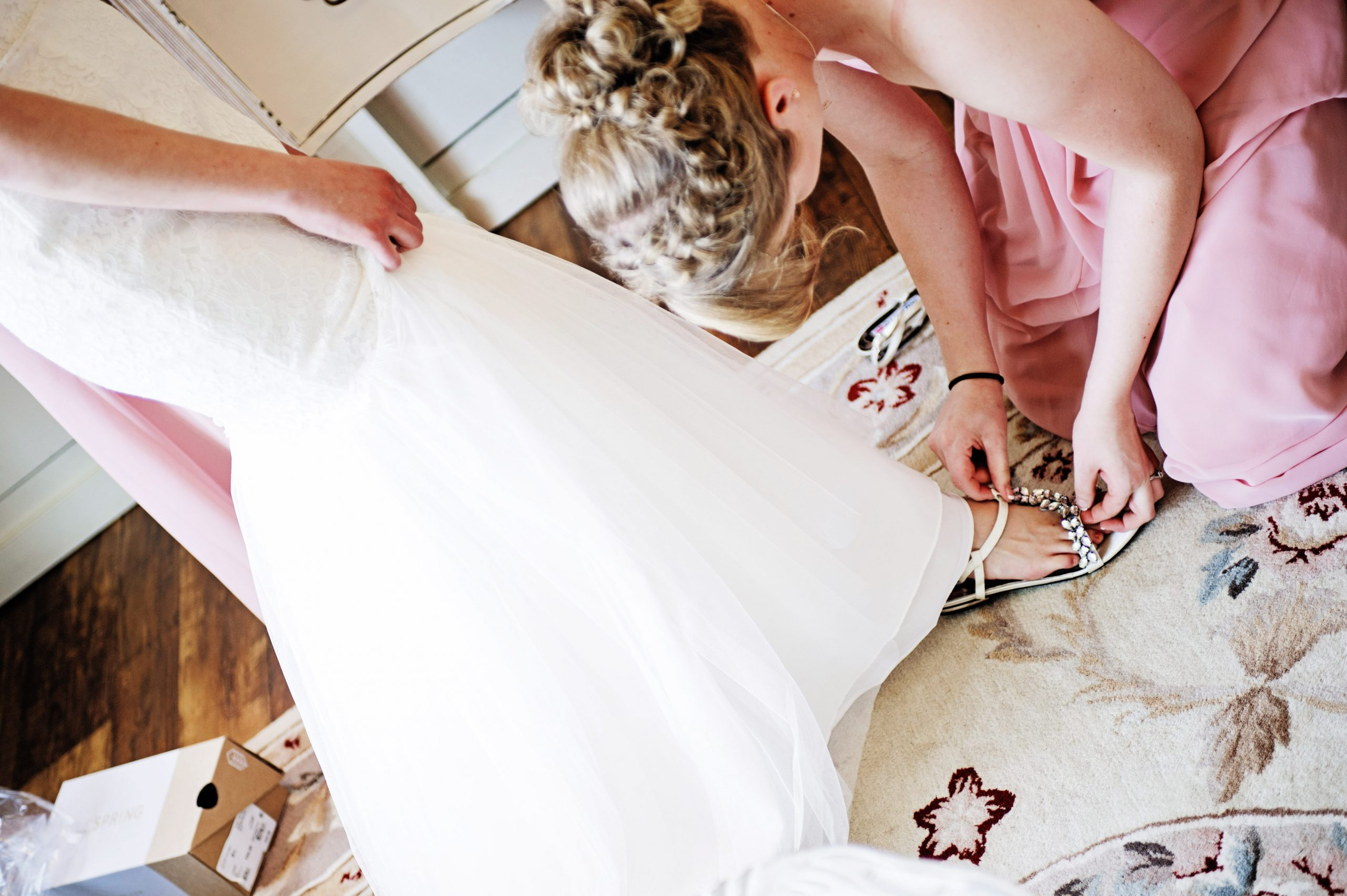 Like a Cinderella story, the bride slips on her shoes and prepares to walk down the isle at Lakeview Farms in York, PA, as Lovefusion Photography beautifully hones in on the details. Featured in Dream Weddings.