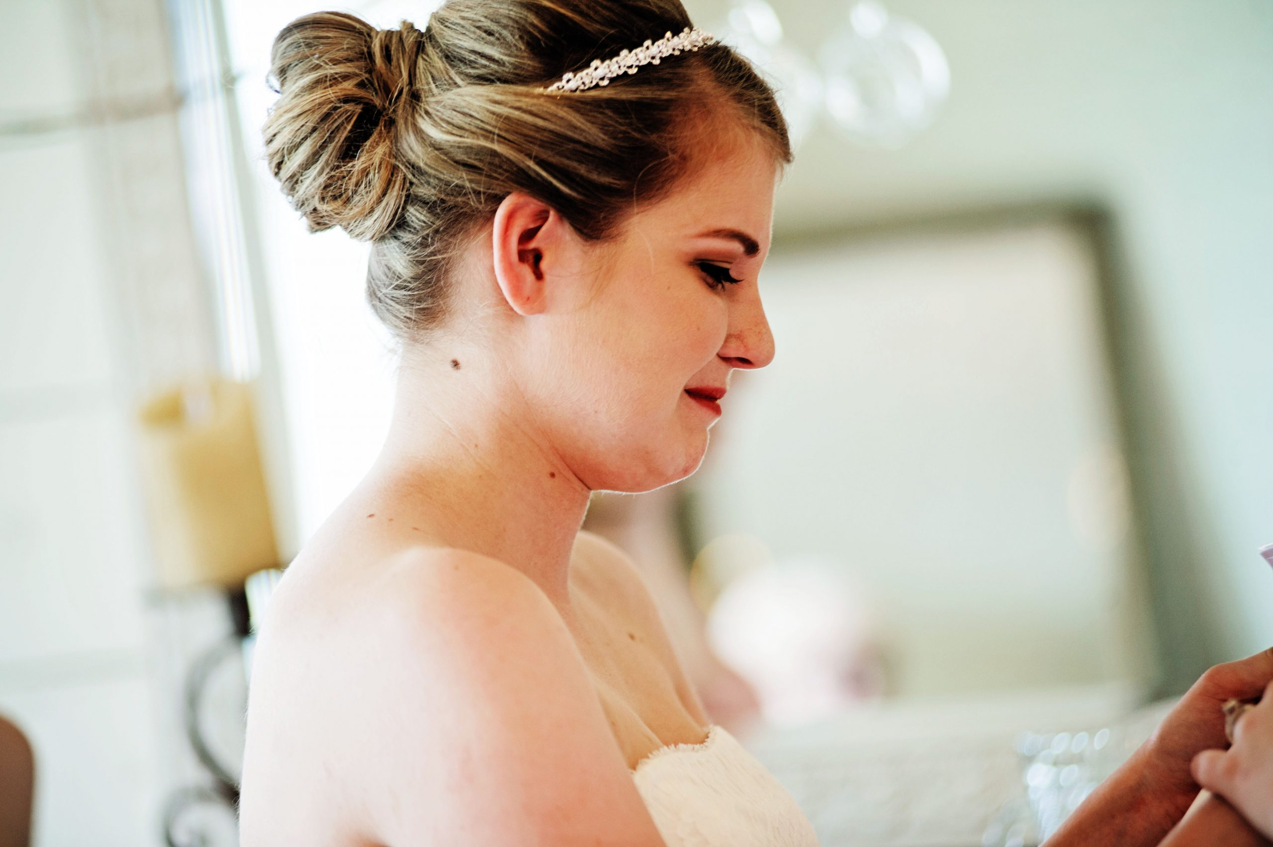 A letter from her future husband, Kady breaks out in tears in the brides suite at Lakeview Farms of York, PA. Lovefusion Photography had the pleasure of capturing this moment. Featured in Dream Weddings.