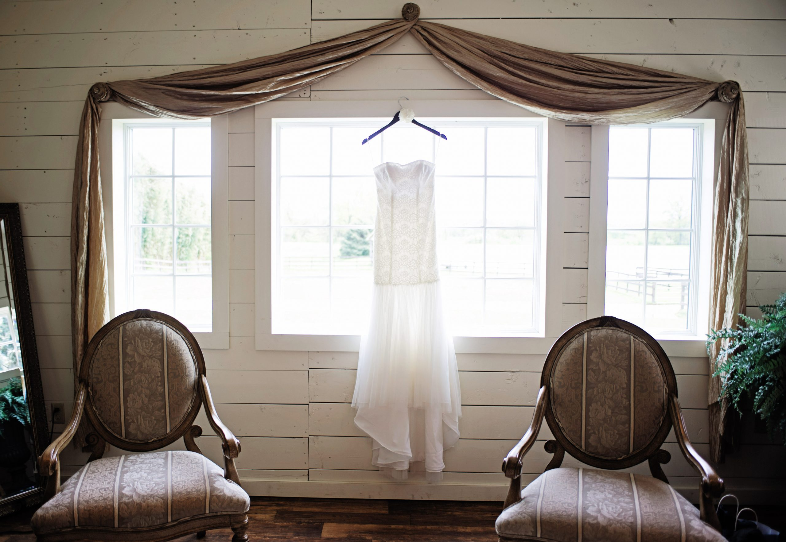 A wedding dress represents the bride. Lovefusion Photography angelically photographs Kady's dress she is to wear down the isle at Lakeview Farms of York, PA. Featured in Dream Weddings.