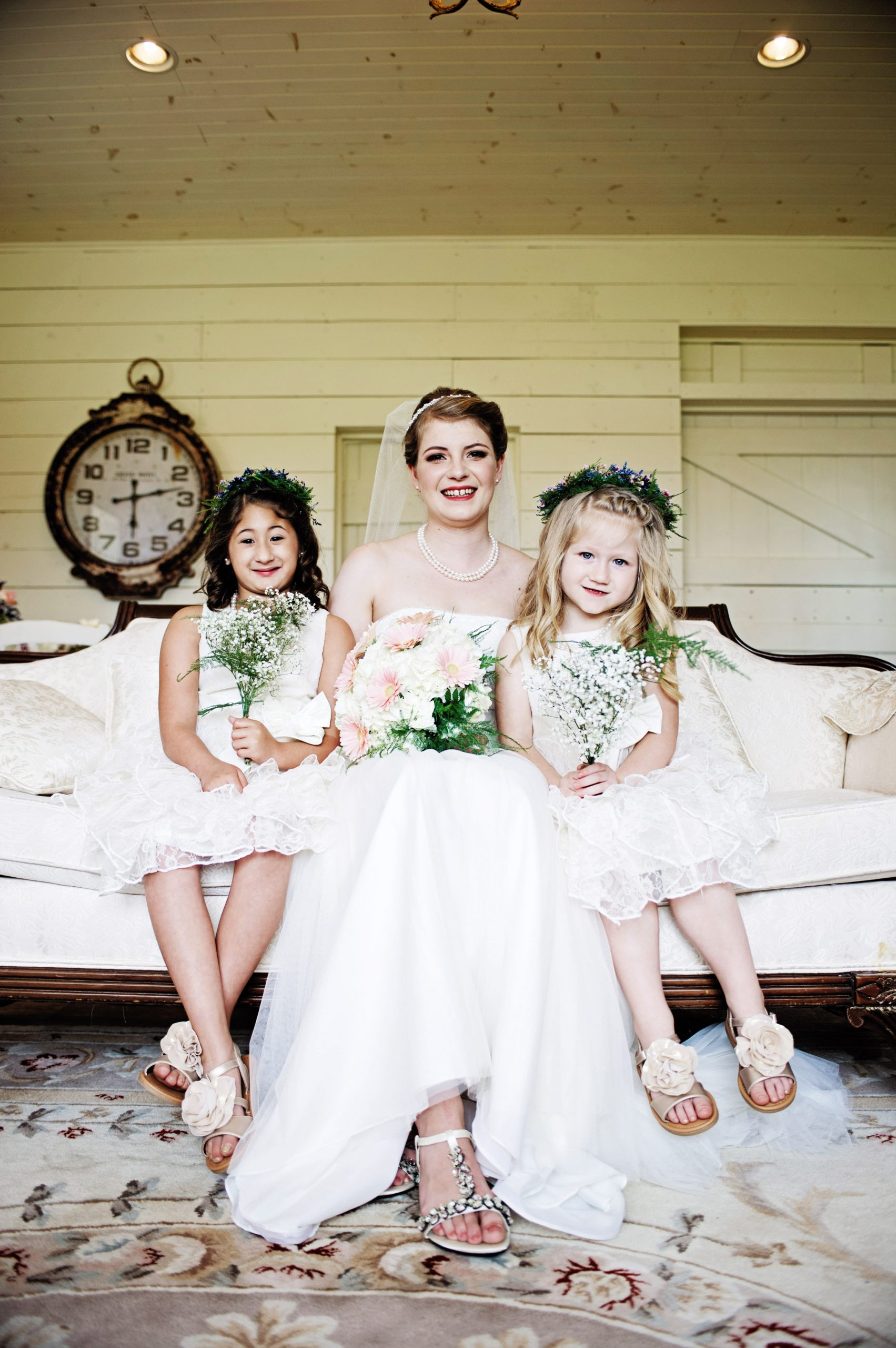 Cute shot by Lovefusion Photography of the bride to be partnered by her flower girls at Lakeview Farms in York, PA. Featured in Dream Weddings.
