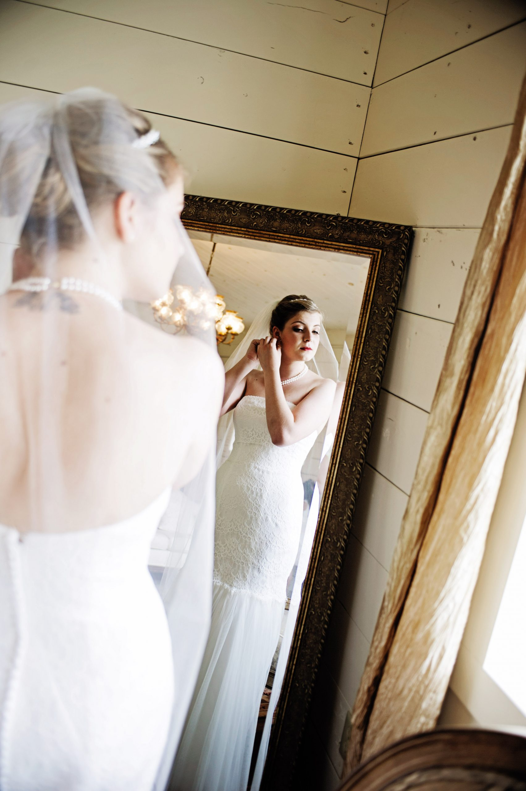 Putting together the last touches, Kady is captured by Lovefusion Photography at Lakeview farms of York, PA. Featured in Dream Weddings.