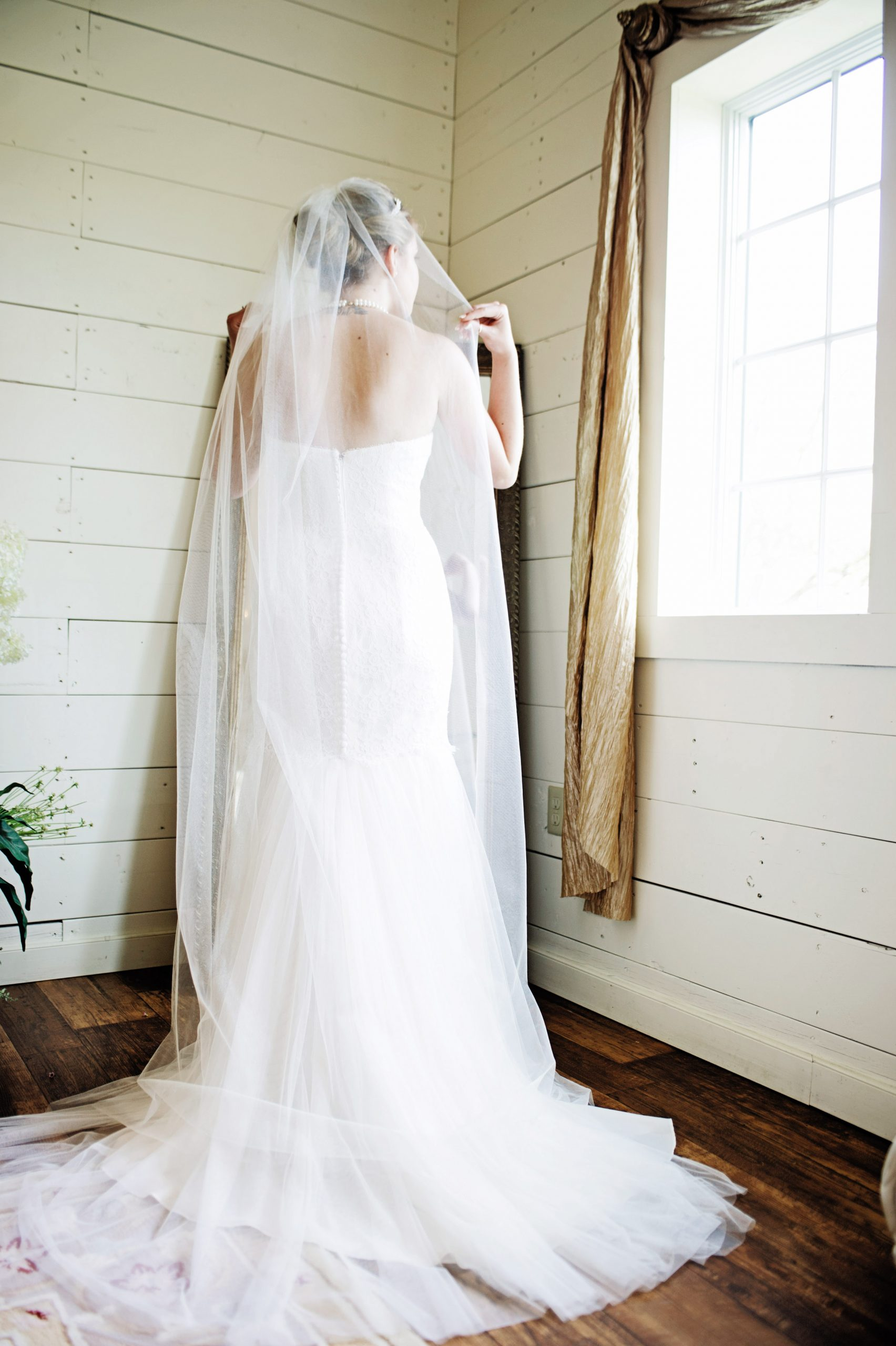 Kady onlooking as she prepares to walk down the isle at Lakeview Farms in York, PA. Lovefusion has an eye for lighting when shooting this photo. Featured in Dream Weddings.