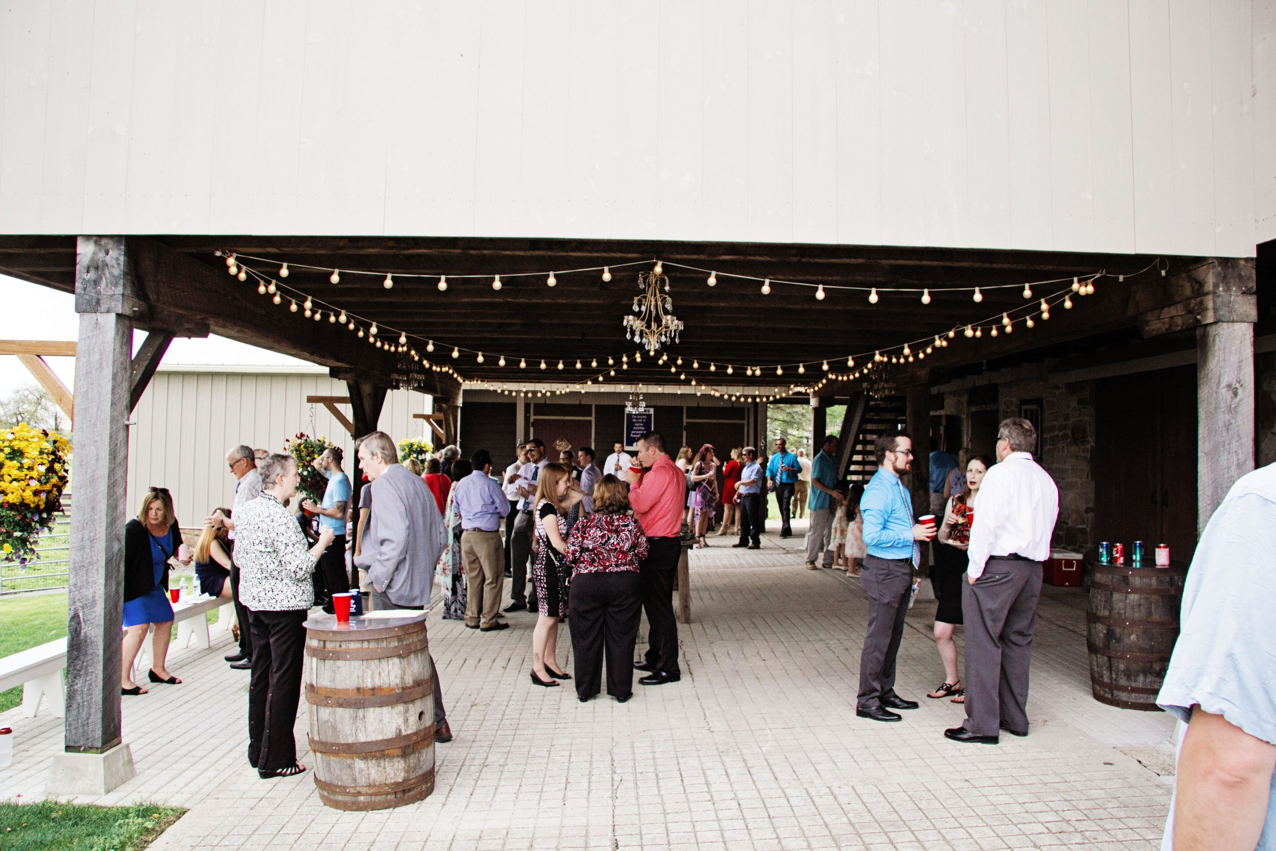 Guests wait for the bride and groom at the reception barn at Lakeview Farms of York, PA, while photographer, Kelsey Kinard of Lovefusion Photography has a chance to take some photos of everyone. Featured on Dream Weddings.