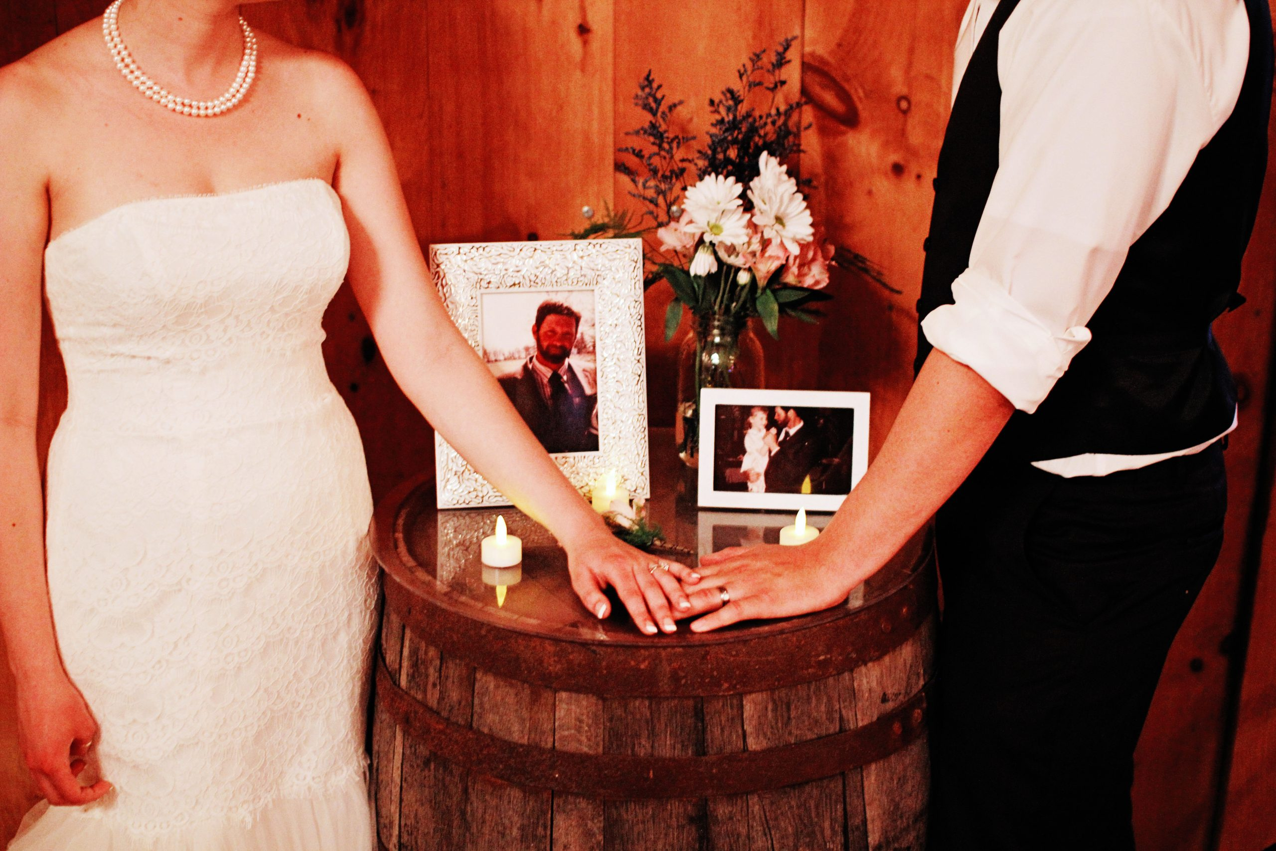 The wedding at Lakeview Farms of York, PA was not just a celebration of newlyweds but of those who have passed. Lovefusion Photography shot this of the couple remembering who they wish could be there to celebrate. Featured on Dream Weddings.