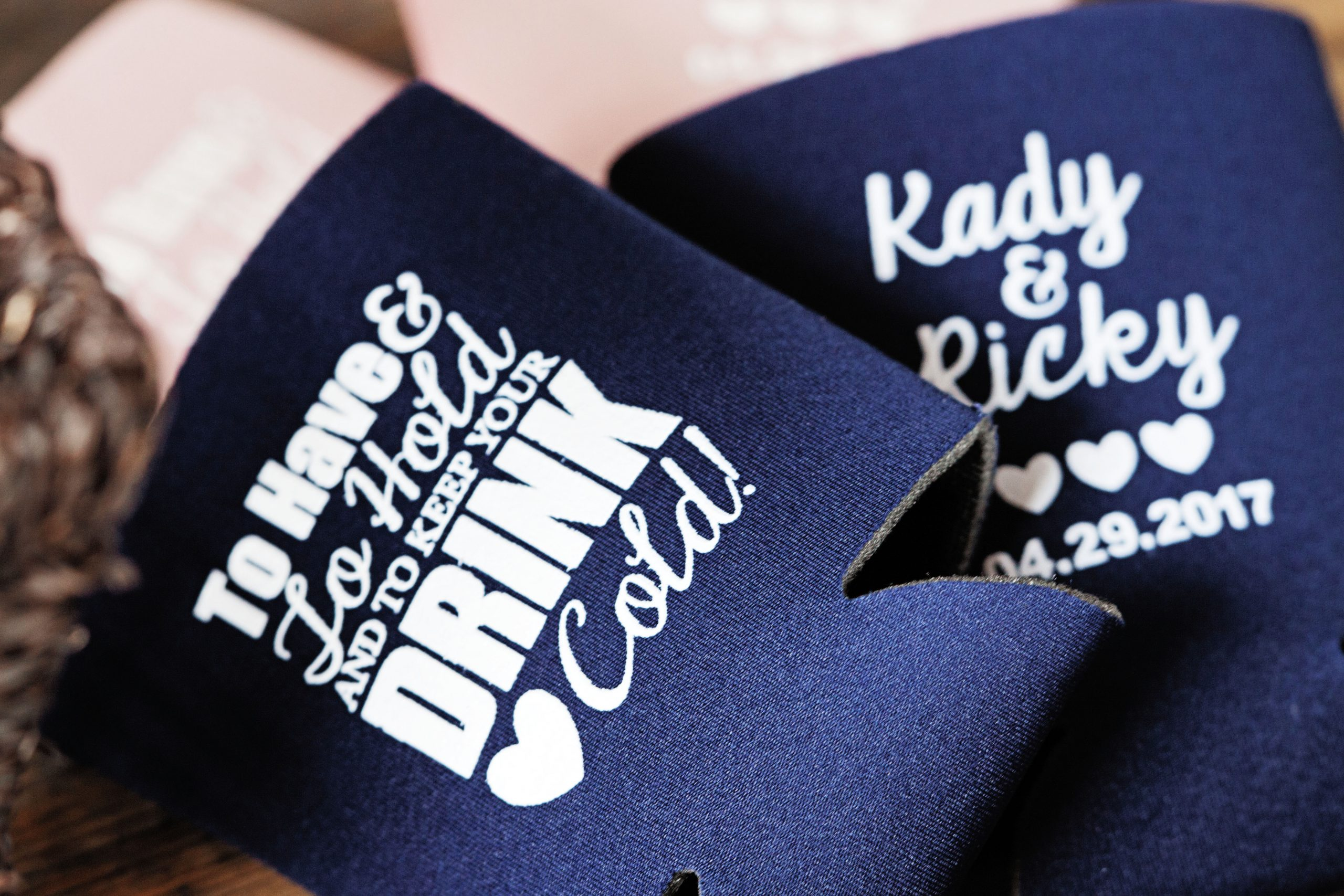 Koozies for a wedding favor is a simple way to give people something they will definitely use. Lovefusion Photography captures this detail photo of the wedding held on the grounds at Lakeview Farms of York, PA. Featured on Dream Weddings.