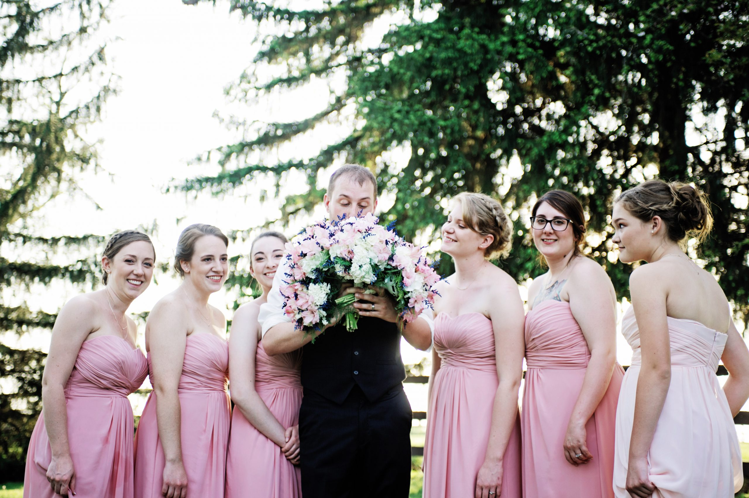 Ricky, along with Kady's bridesmaids, share in a comical photo taken by Lovefusion Photography at Lakeview Farms, York, PA. Featured on Dream Weddings.