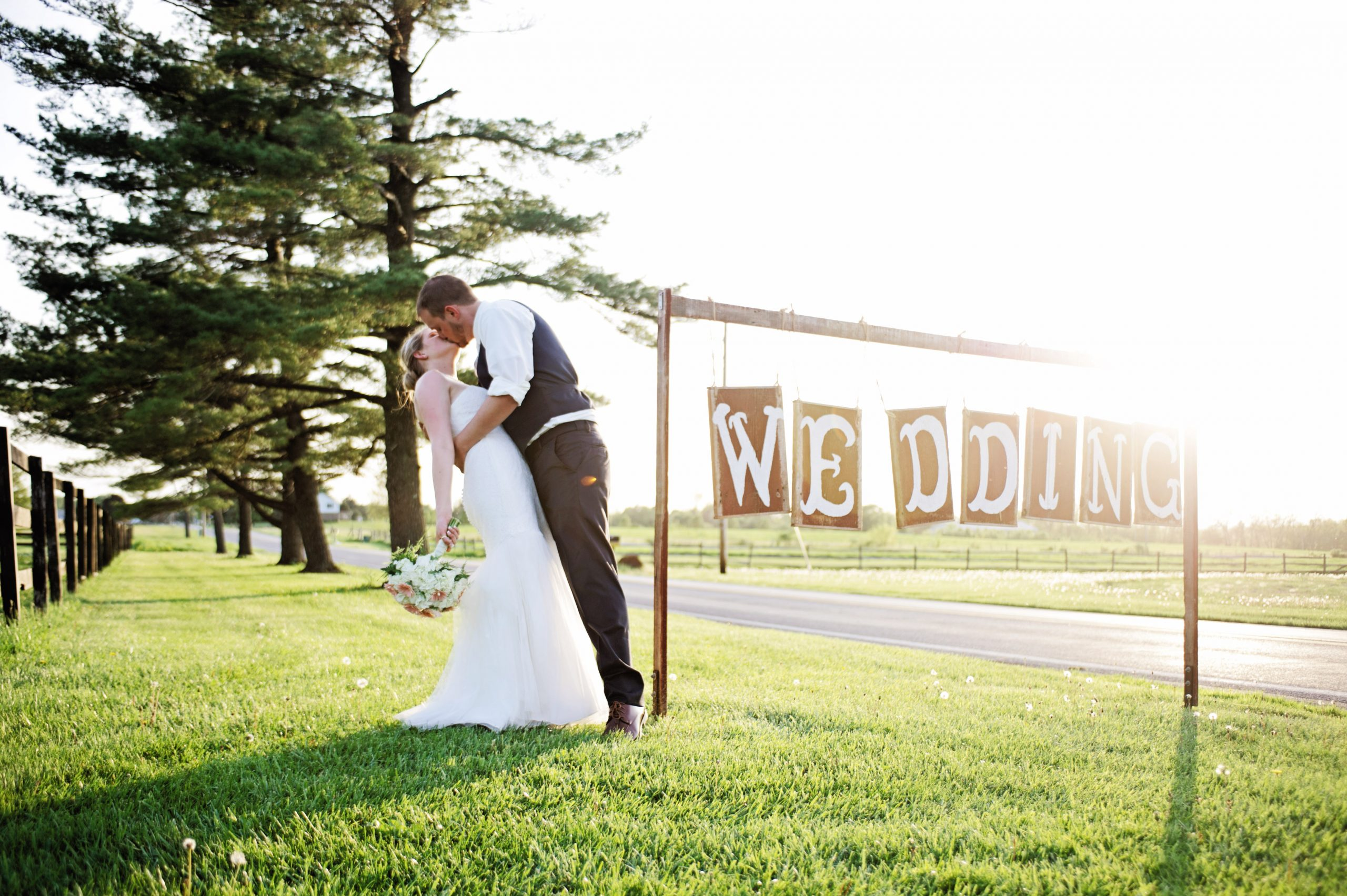 Wedding signage is the perfect way to customize your wedding and this couple did it perfectly. Photographed by Lovefusion, Lakeview Farms offered the perfect venue. Featured on Dream Weddings.