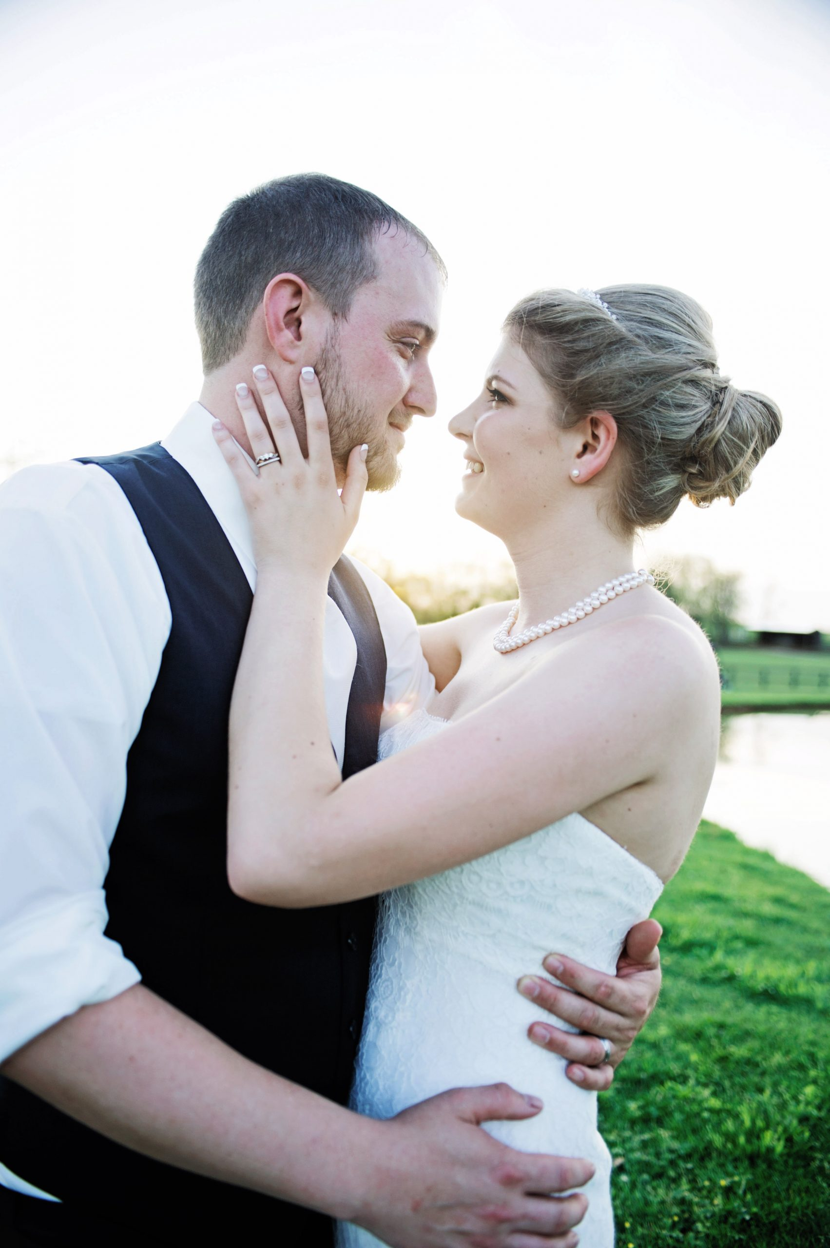 A close up shot of Kady and Ricky showcases her gorgeous ring and clasic pearl necklace at Lakeview Farms in York, PA. Lovefusion Photography did a wonderful job of showing the infatuation the two lovebirds have for each other. Featured on Dream Weddings.