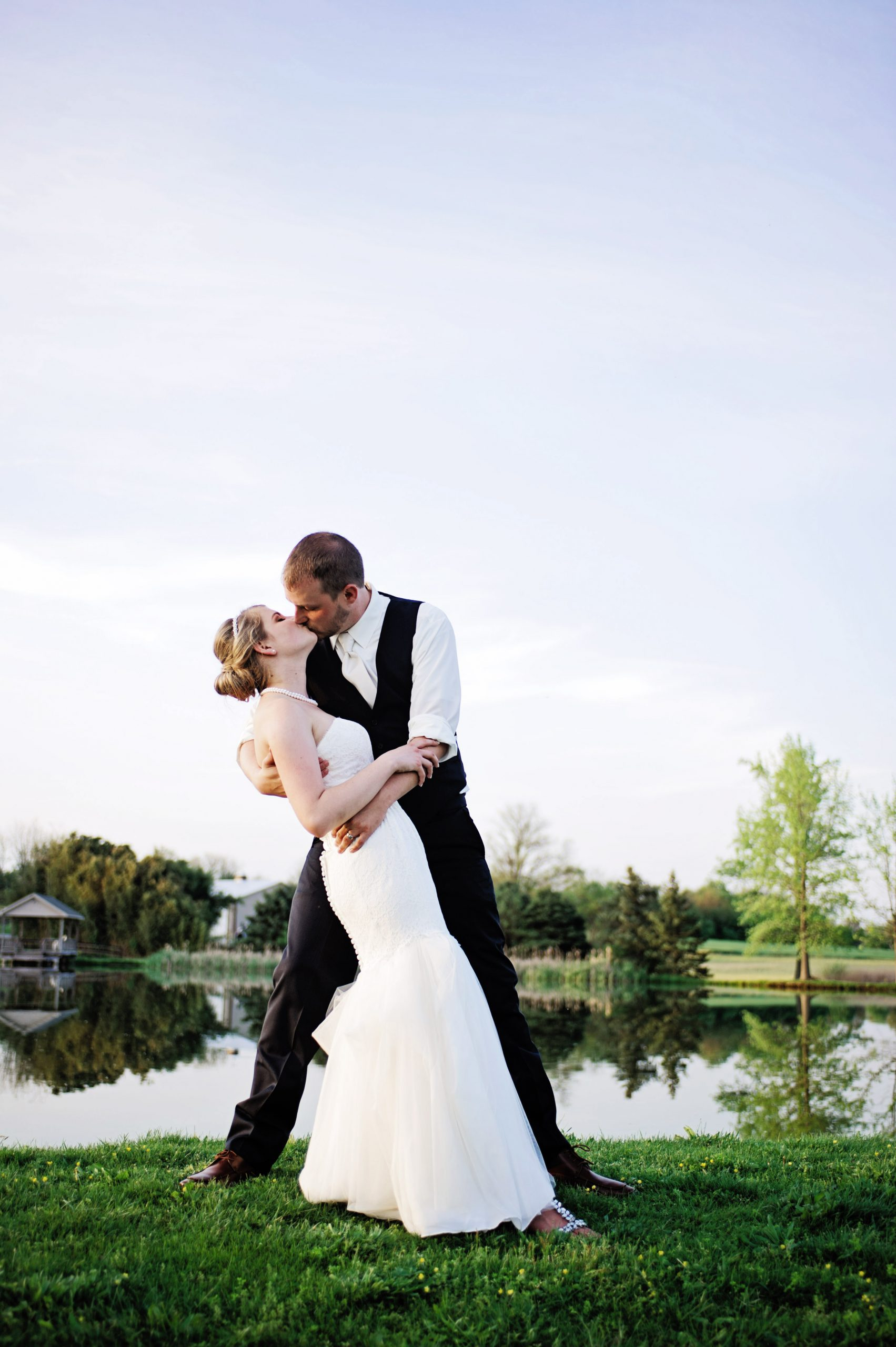 Overlooking the lake at Lakeview Farms in York, PA, Kady and Ricky romanitically embrace each other with a kiss. Classic in both positioning and love for each other, the two share a forever bond. Featured on Dream Weddings.