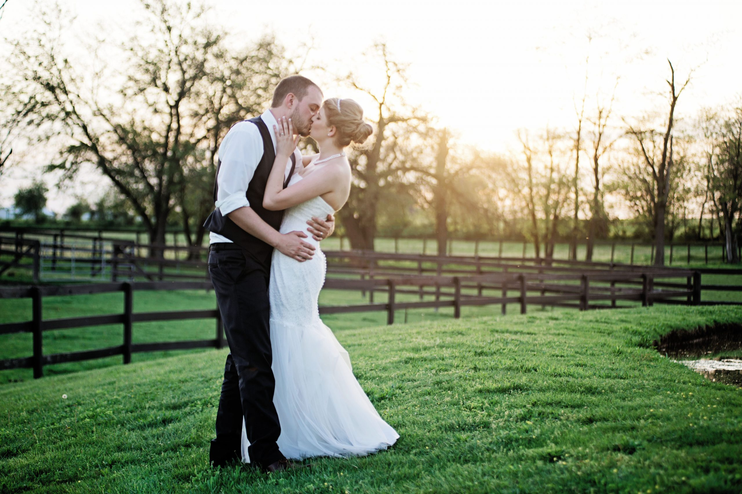 Lakeview Farms of York, PA proved to be the perfect wedding destination for Kady and Ricky. Horses, stables and plenty of land for wedding-scape, the two explred the property with Photographer Kelsey Kinard of Lovefusion Photography. This photo will live on for generations. Timeless. Featured on Dream Weddings.
