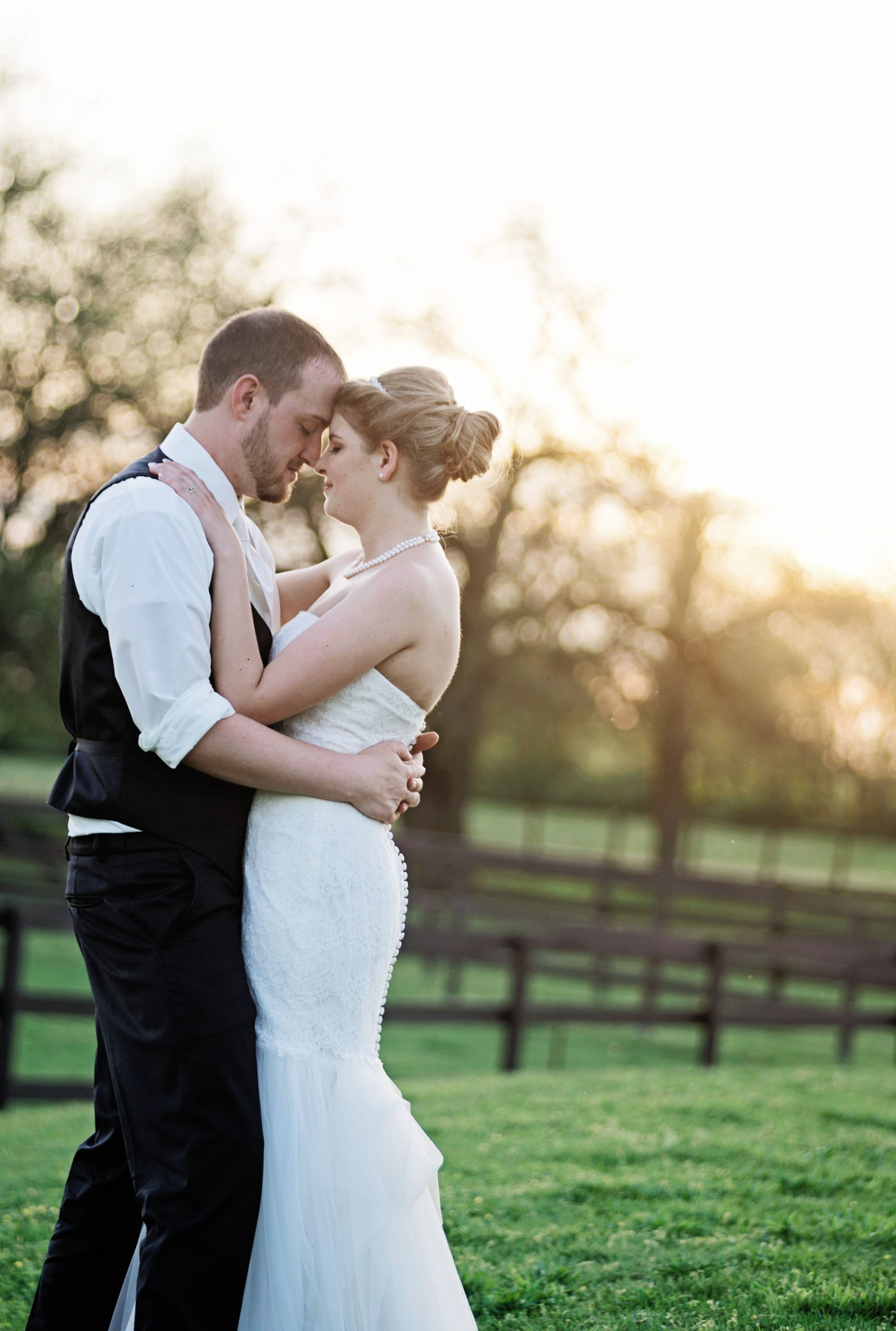 The sunlight hit just right for this happy newly wedded couple at Lakeview Farms in York, PA. Photographed by Lovefusion, the two look madly in love. Featured on Dream Weddings.