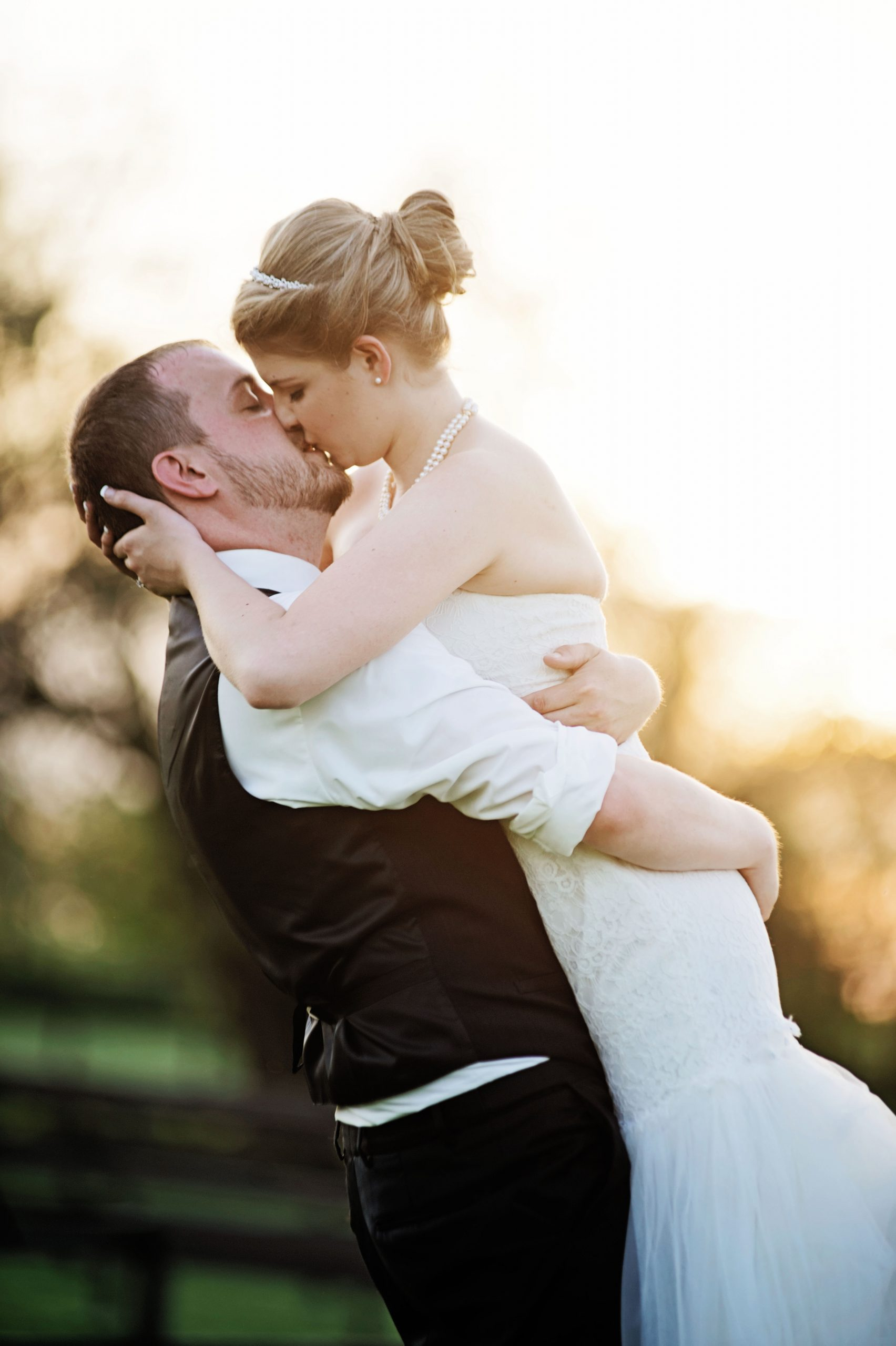 A loving kiss captured by Lovefusion Photography at Lakeview Farms in York, PA. Featured on Dream Weddings.
