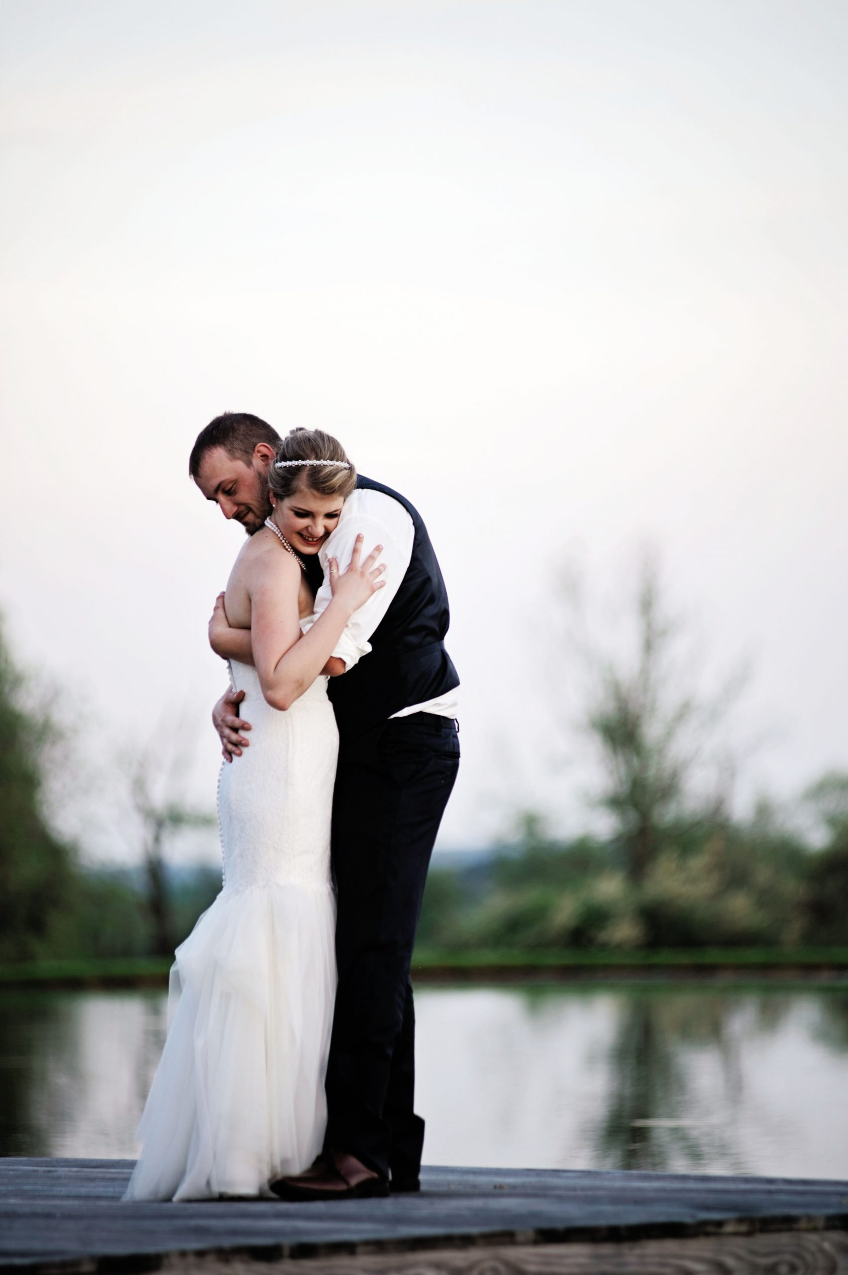 Kady and Ricky celebrate their marriage at Lakeview Farms in York, PA with photo session by Lovefusion at dusk on the dock. Featured on Dream Weddings.